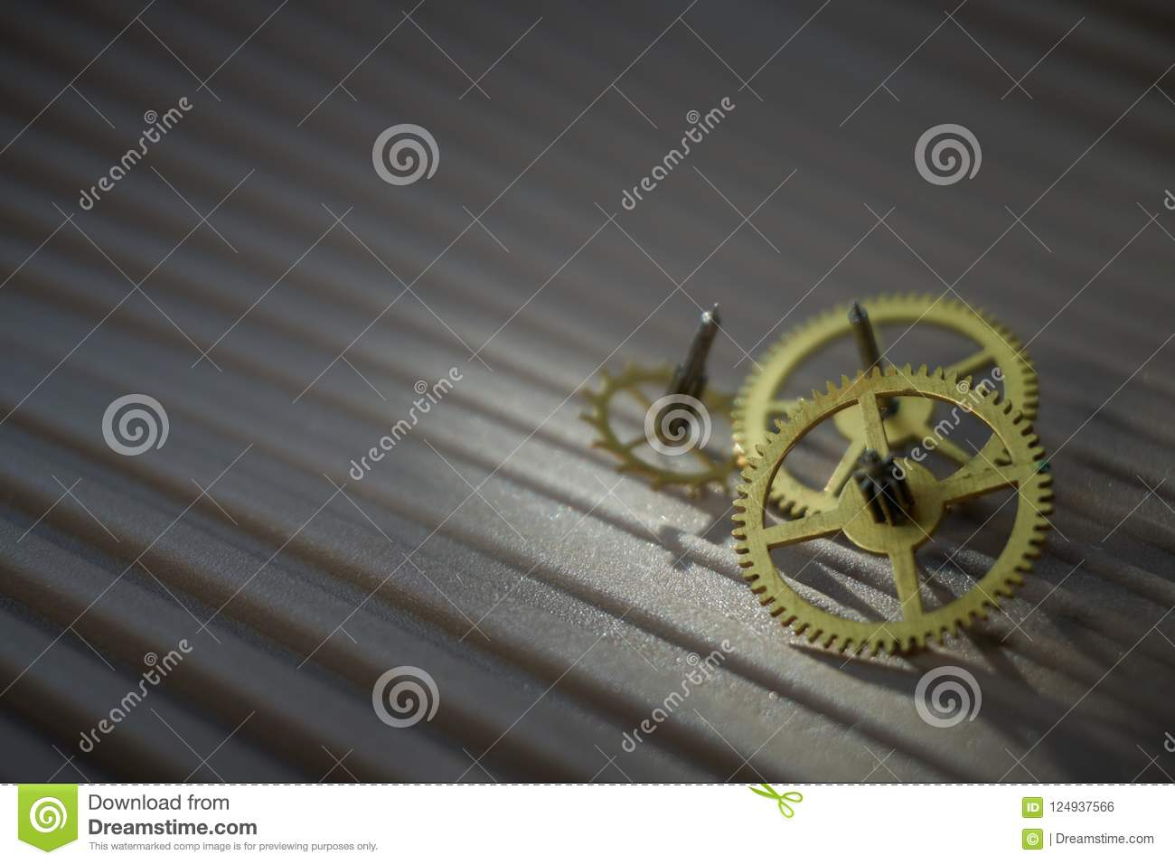 Three different toothed brass metal cog wheels