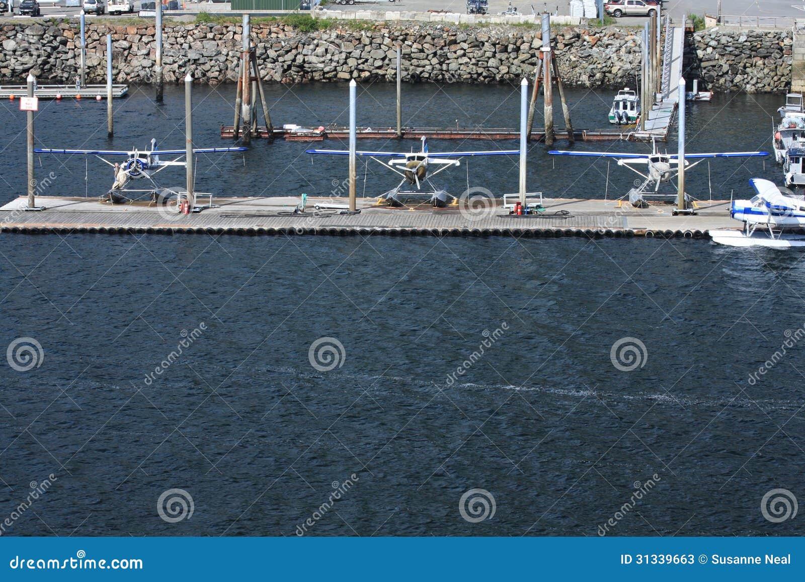 Three docked float planes in Ketchikan, Alaska
