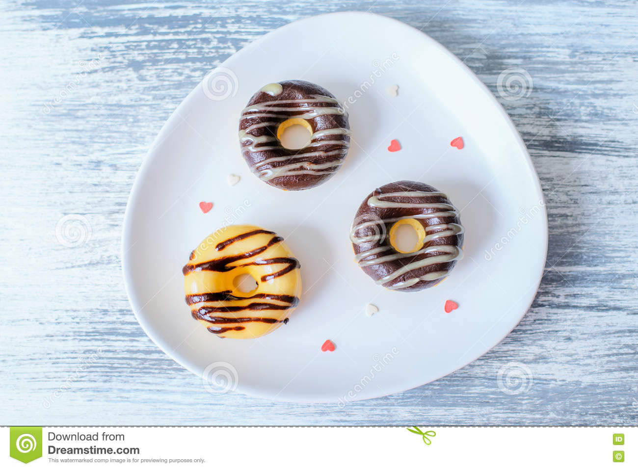 Three Donuts on plate decorated