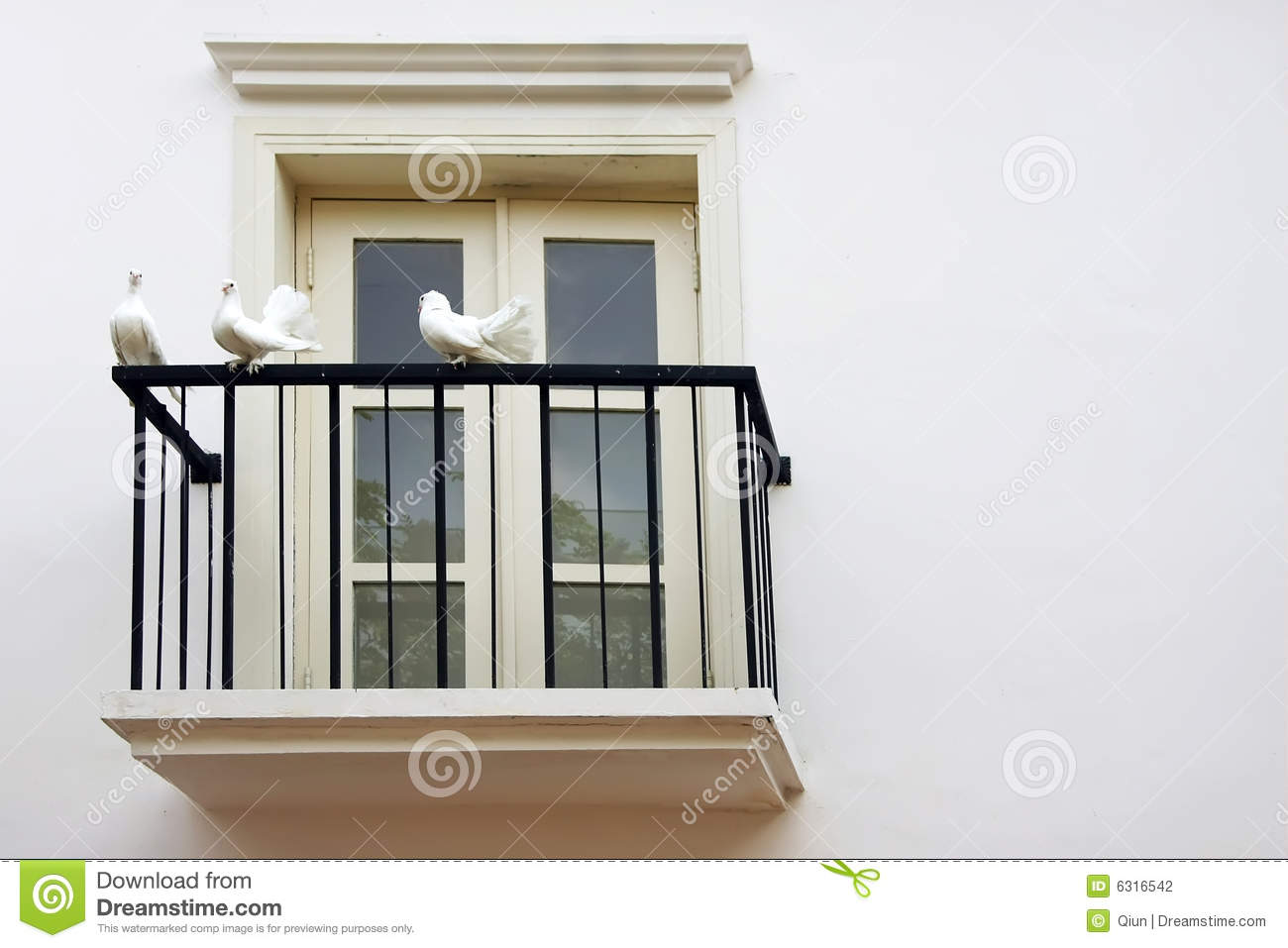Three dove at balcony windows stock photography image for Pic of balcony
