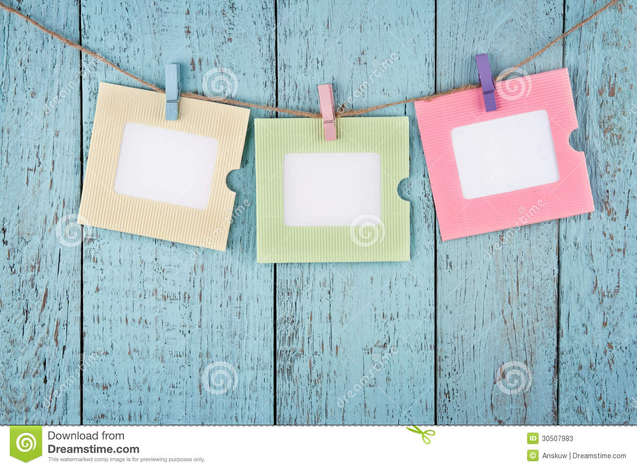 Three Empty Photo Frames Hanging With Clothespins Stock