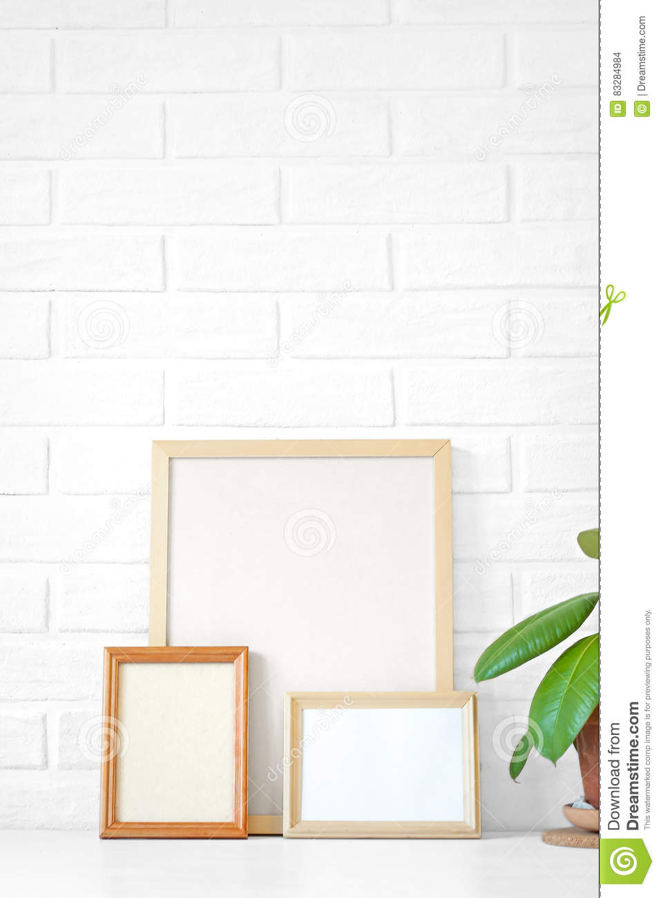 Three Empty Wooden Picture Frame With Copy Space On Table, Paint ...