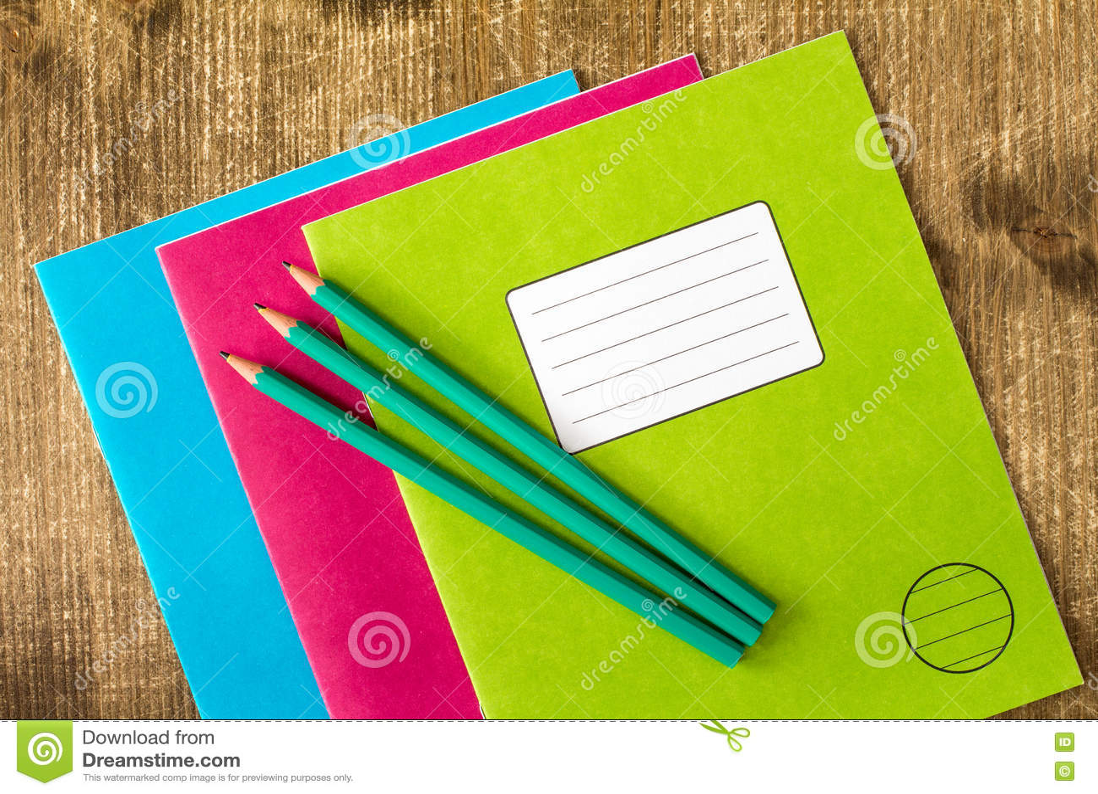 Three Exercise Books And Three Pencils Stock Photo - Image