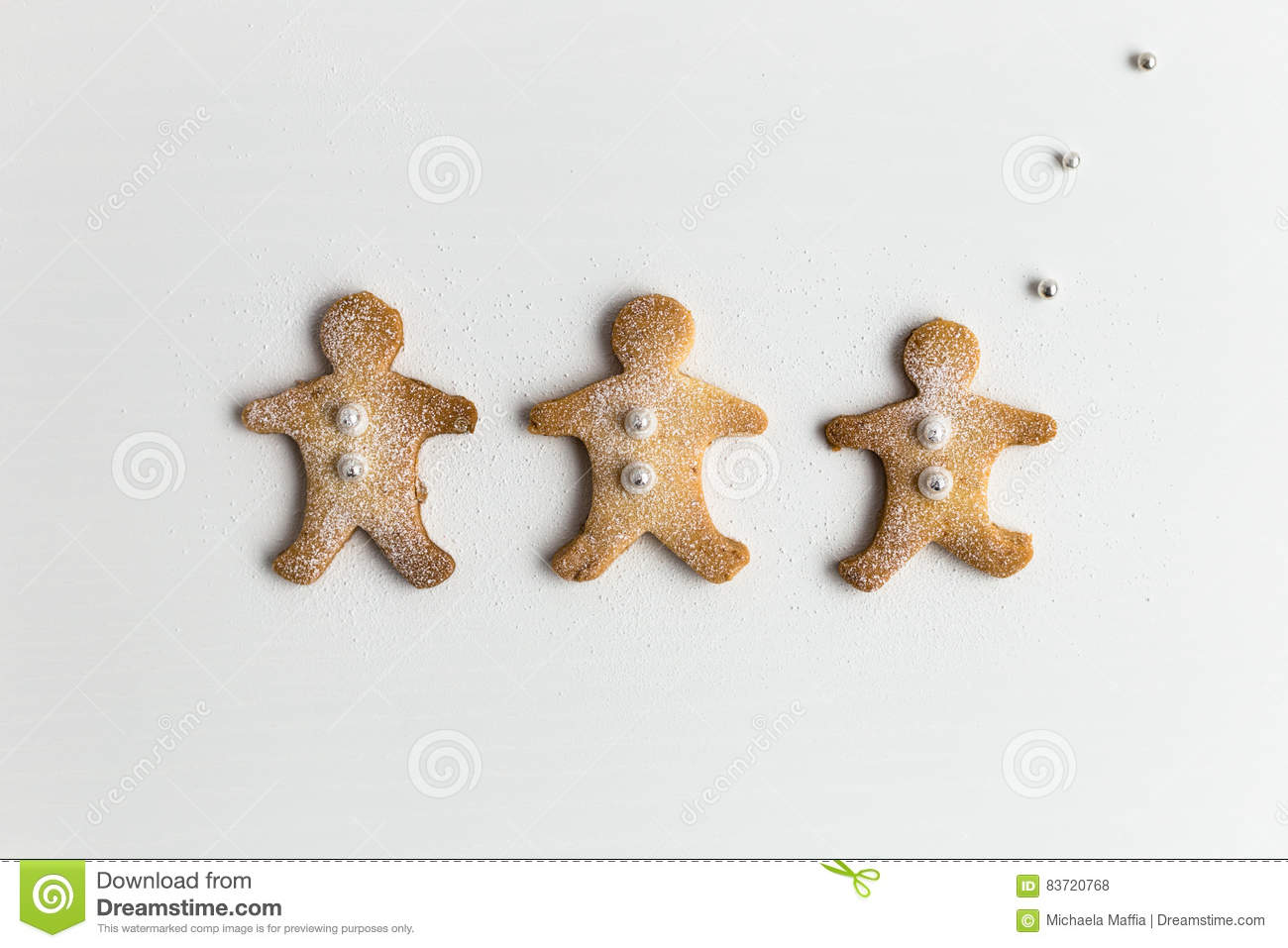 Three Festive Gingerbread Men Biscuits On White Background Stock Photo