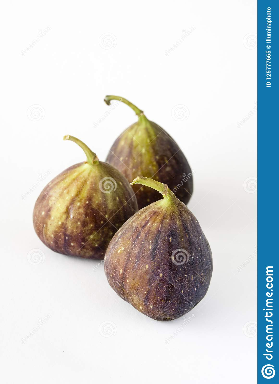 Three fig fruits on a white background.