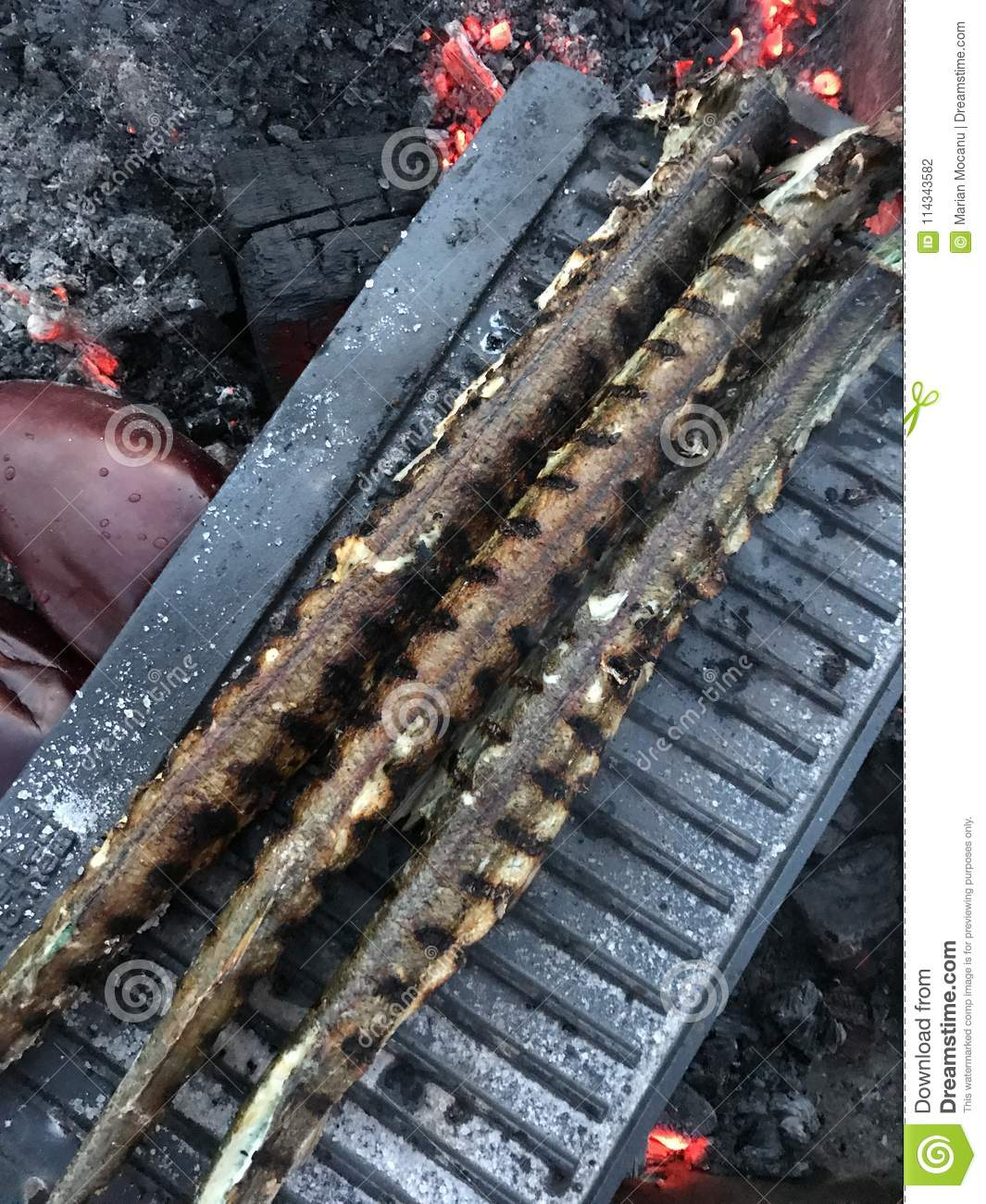 Three fish on grill - outdoor cooking