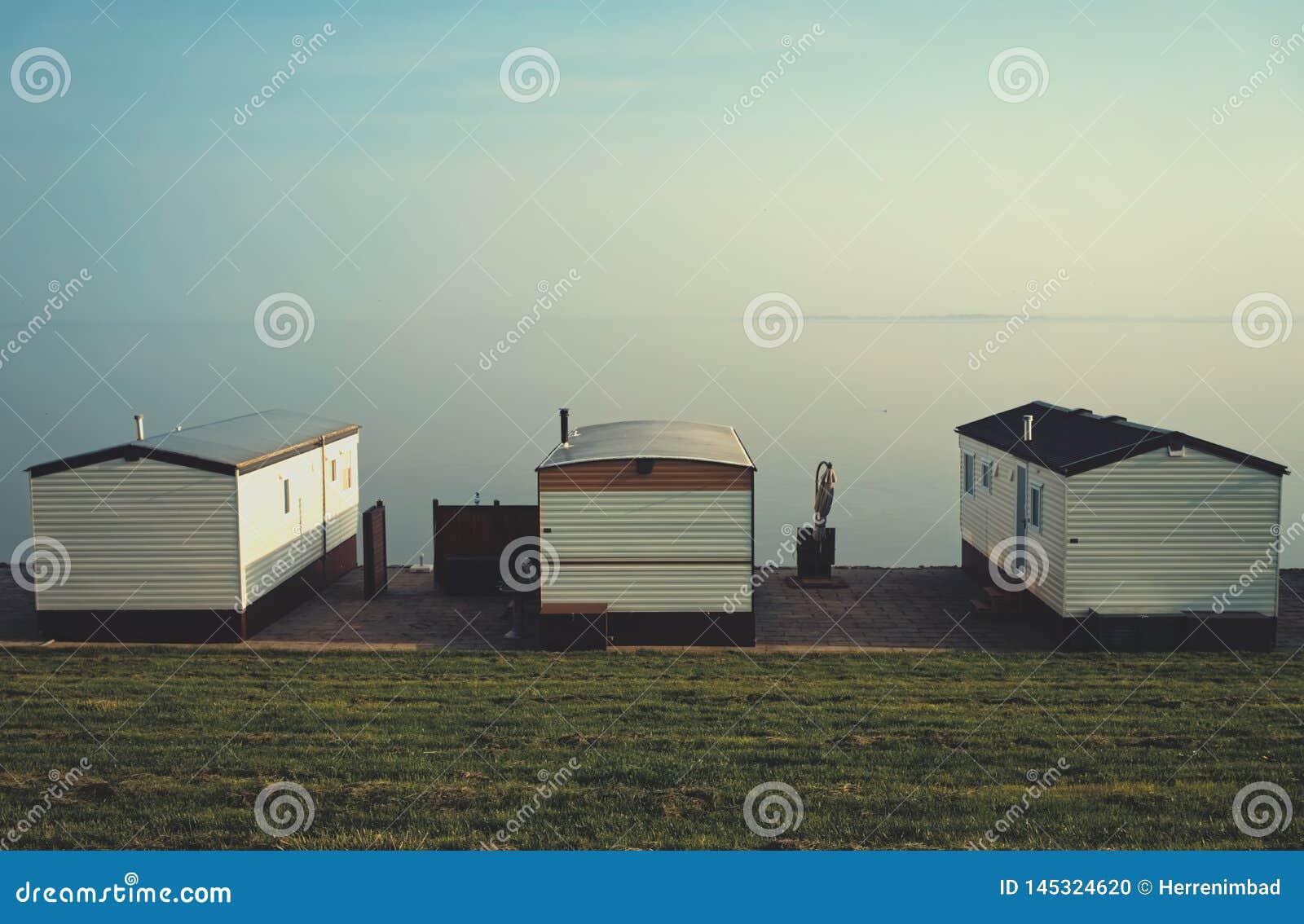 Three fisherman huts