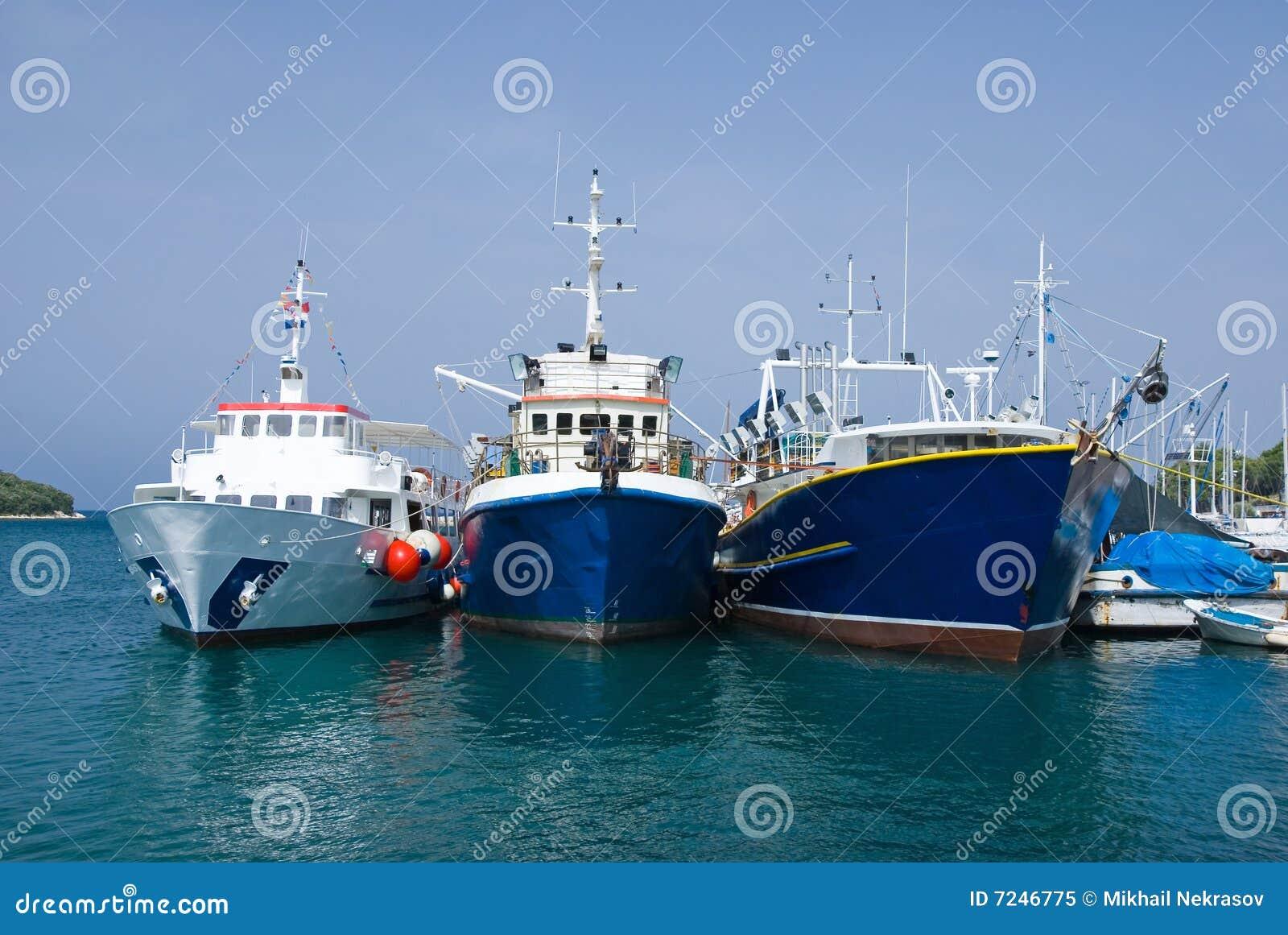Three fishing boats in the port of Vrsar