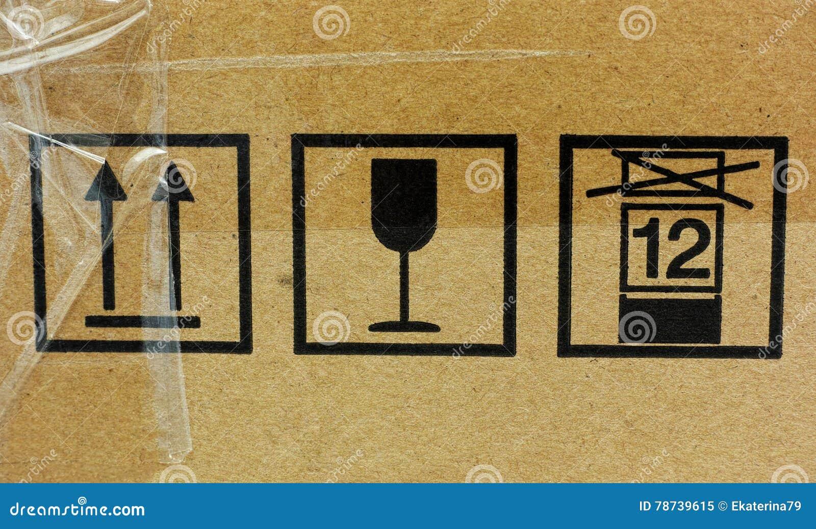 Three fragile symbol on cardboard