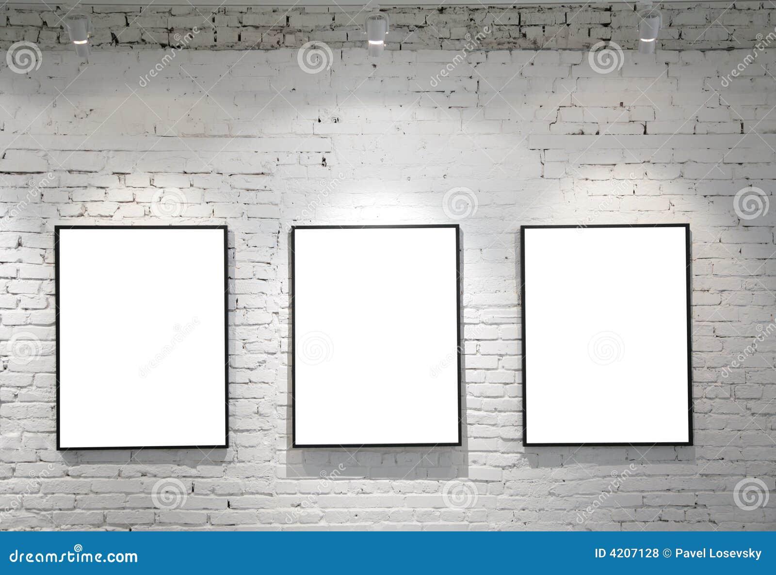 Three frames on brick wall