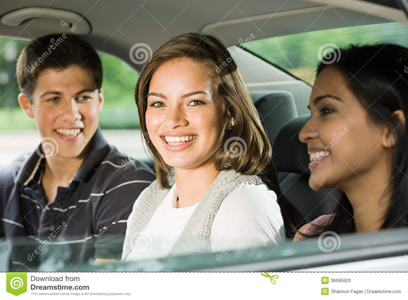 Three friends in the back of a car