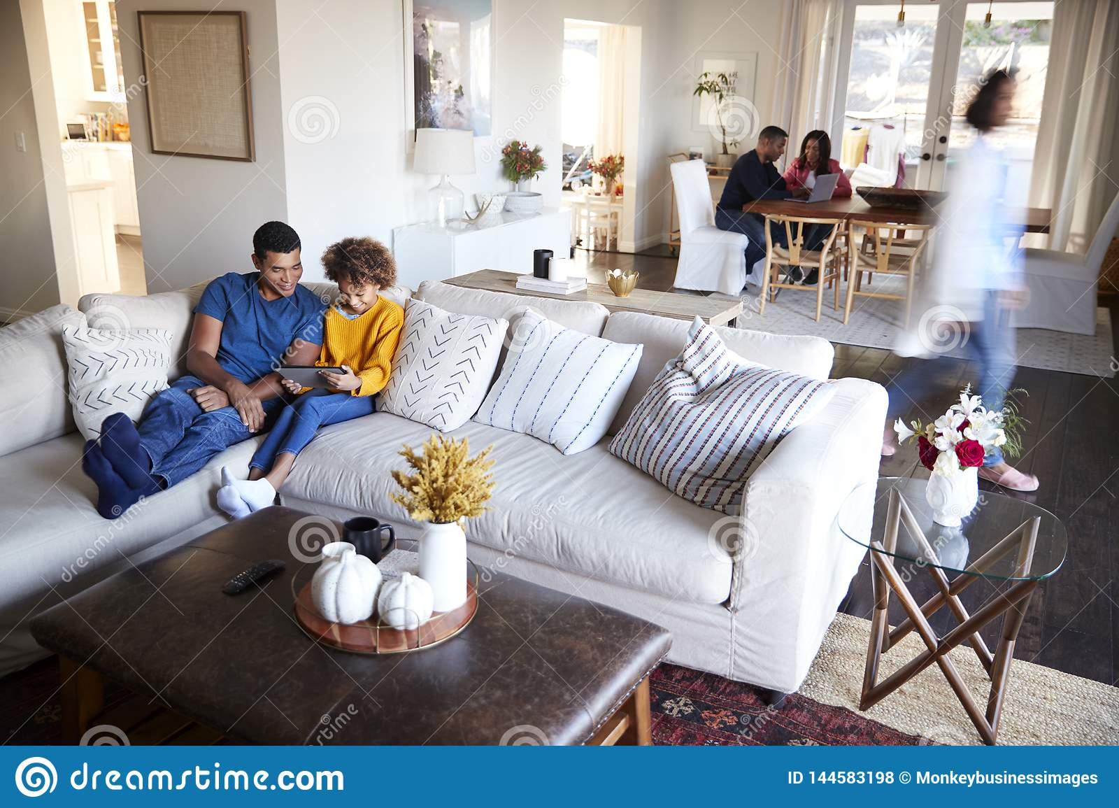 Three Generation Family Family Spending Time In Their Open Plan Living Room And Kitchen Diner Father And Daughter In The Foregrou Stock Photo Image Of American Domestic 144583198