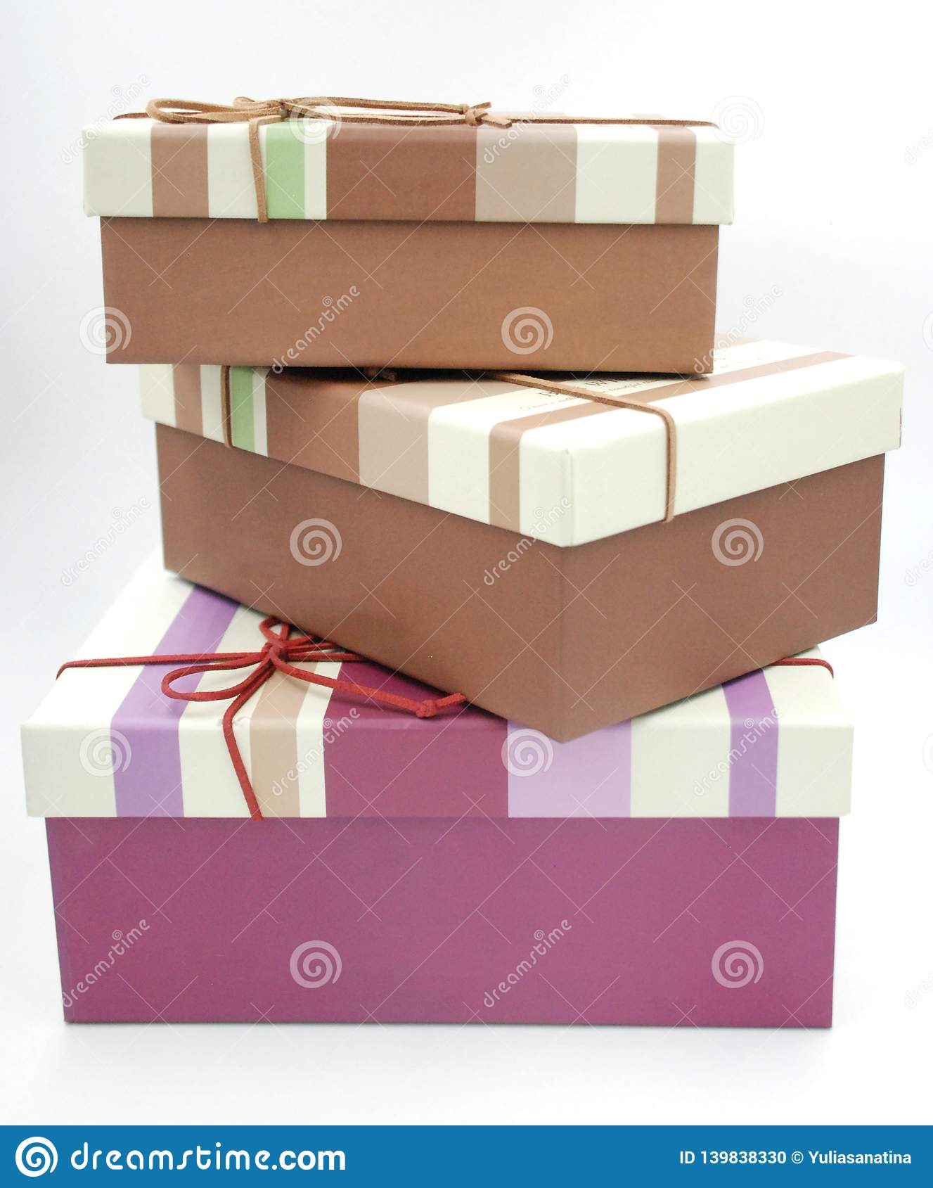 Three gift boxes with the bow tie on the top