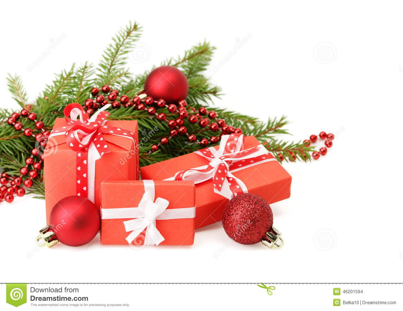 Three Gift Boxes And Christmas Tree Branch Stock Photo - Image of ...