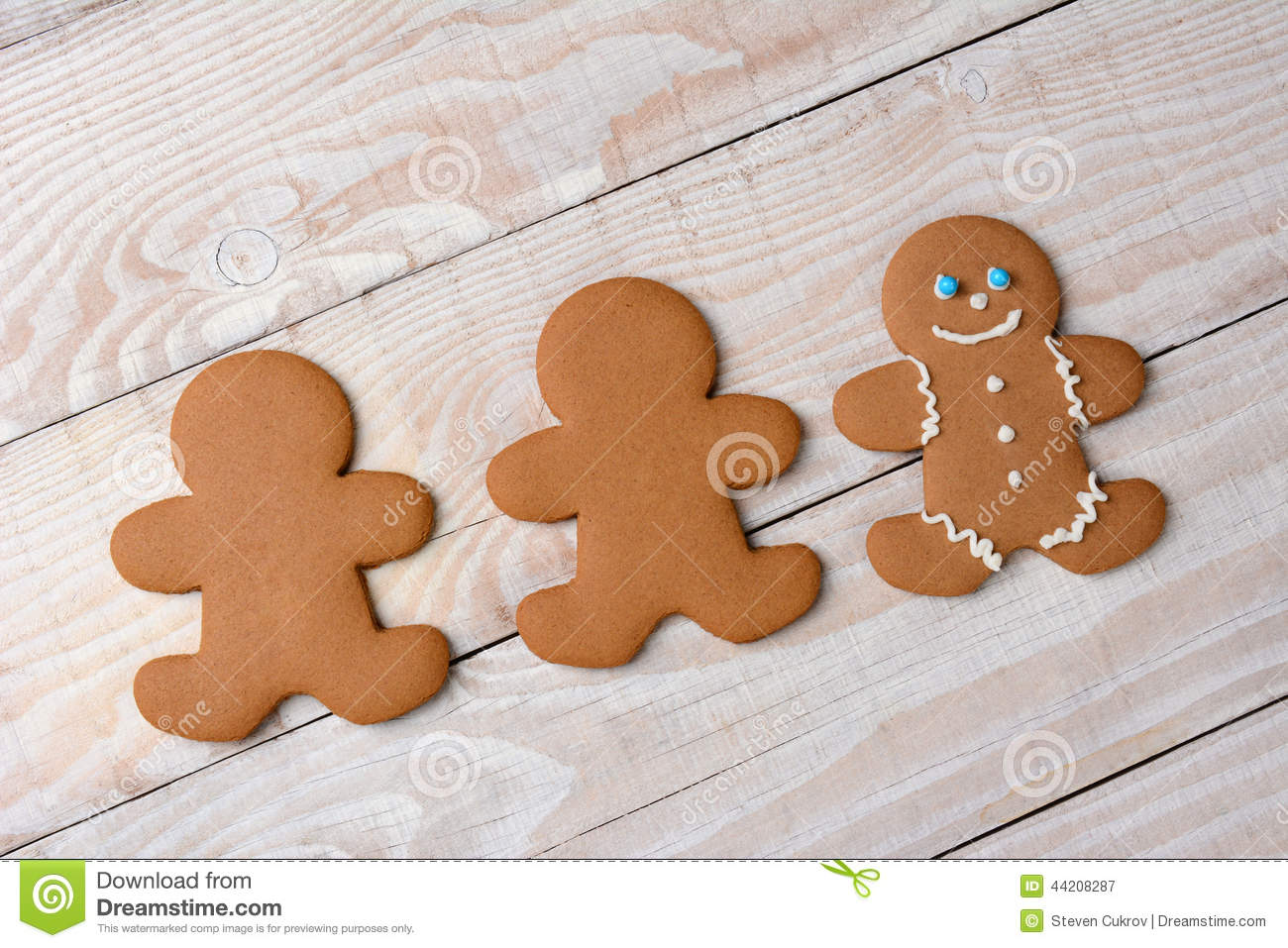 Three Gingerbread Cookies One Decorated Stock Photo