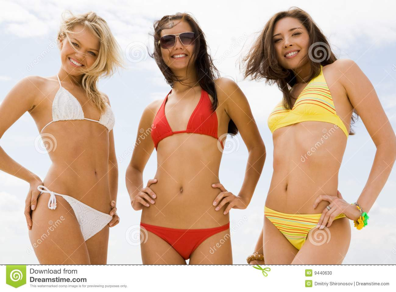 Only Three women in bikini swimwear