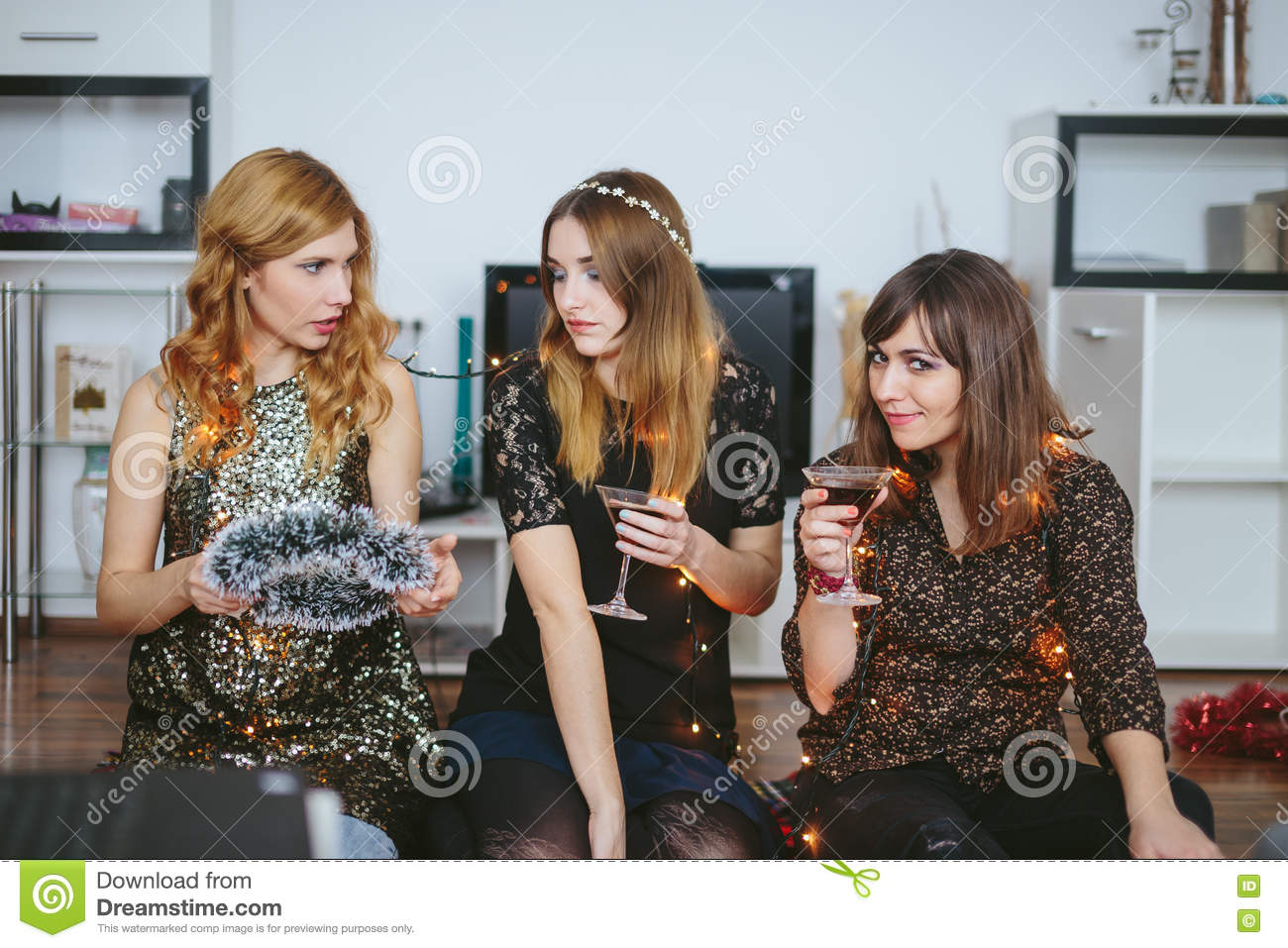three girls decorating their room for a christmas or new year`s