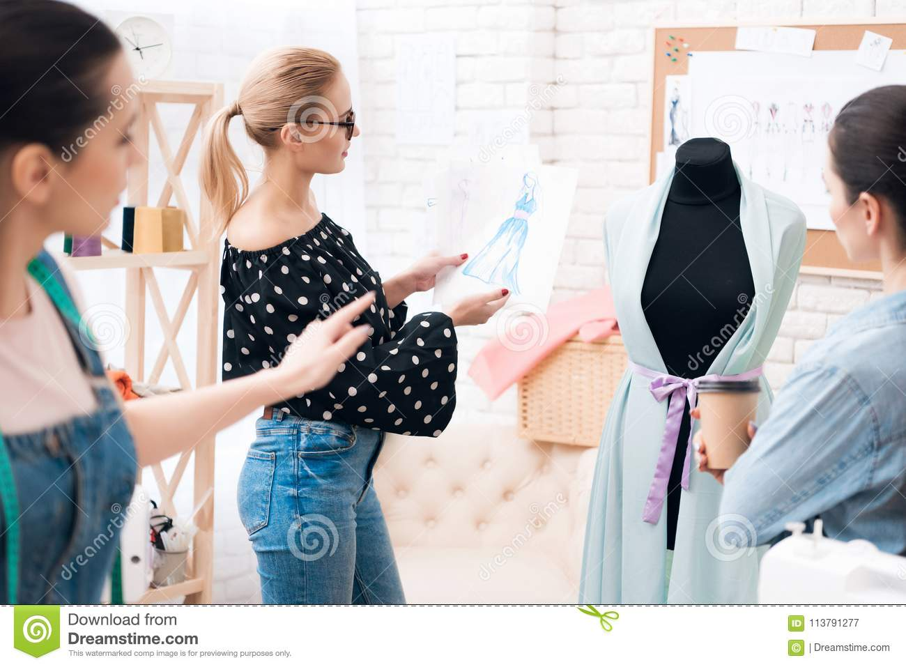 Three Women At Garment Factory They Are Discussing Design Of The