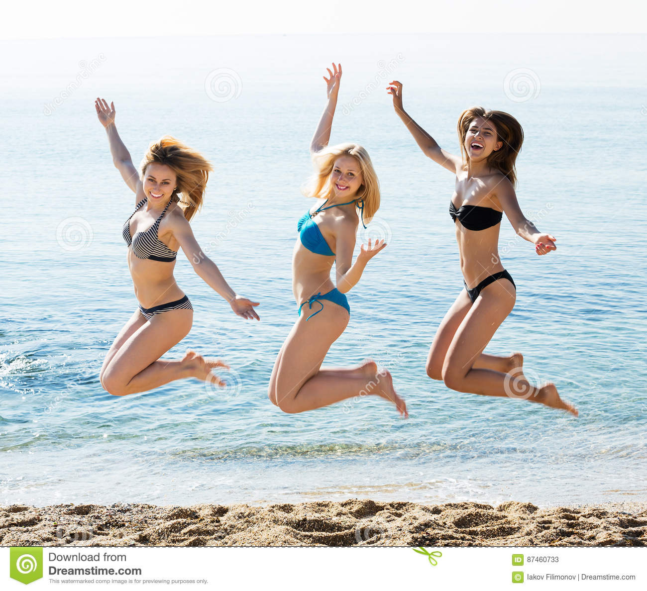 Three girls jumping on beach