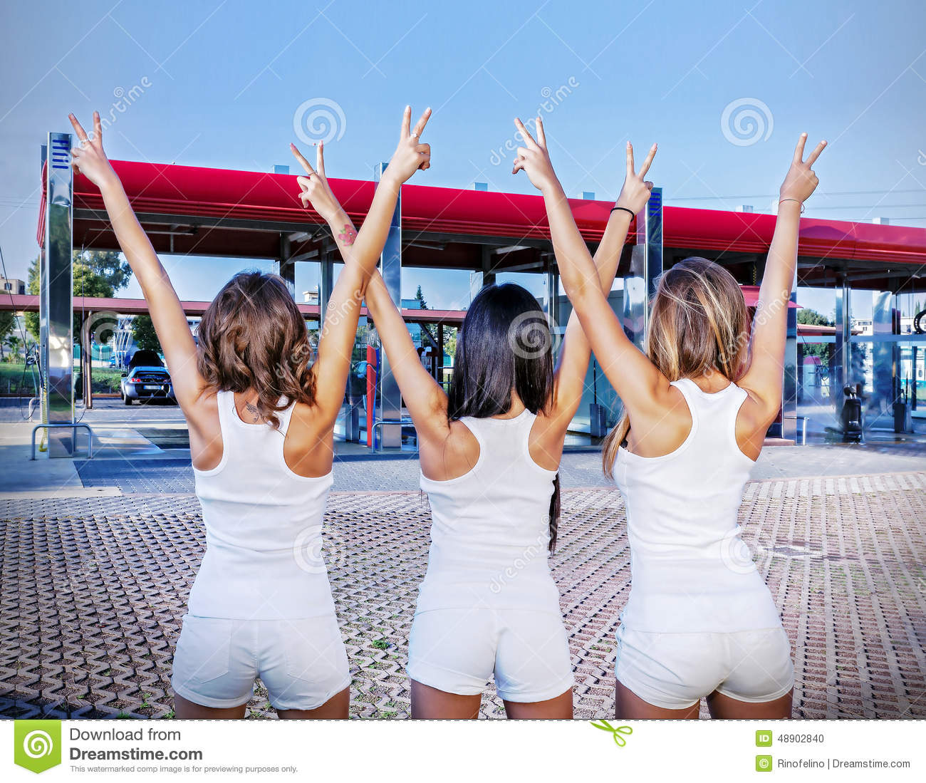 Three Girls With The Sign Of Victory Stock Photography