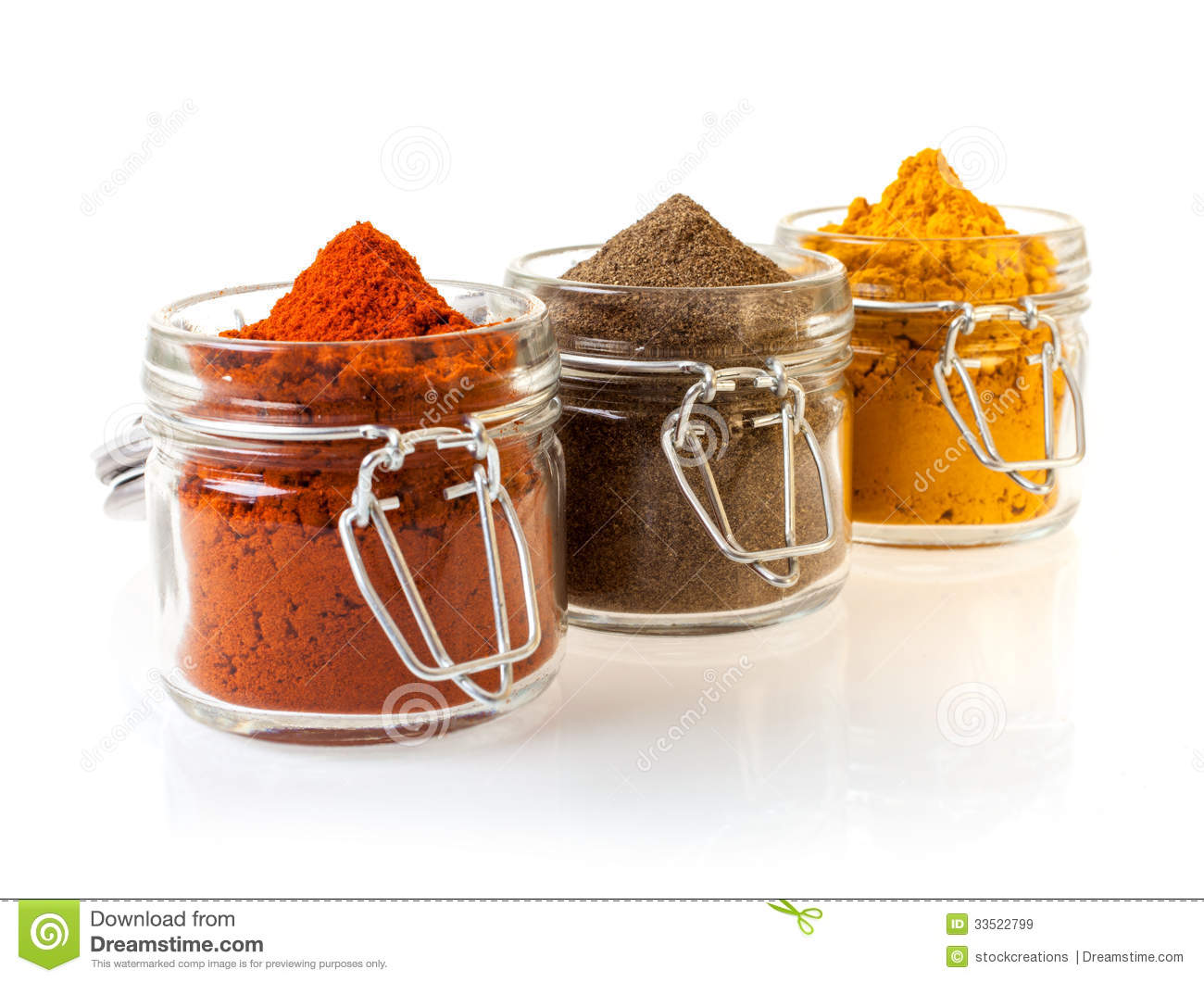 Three glass jars filled with spices royalty free stock