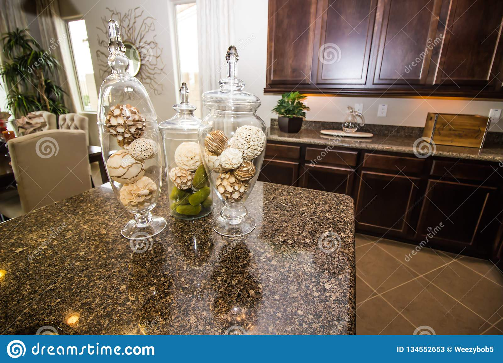 Three Glass Vases On Modern Kitchen Counter Stock Image - Image of