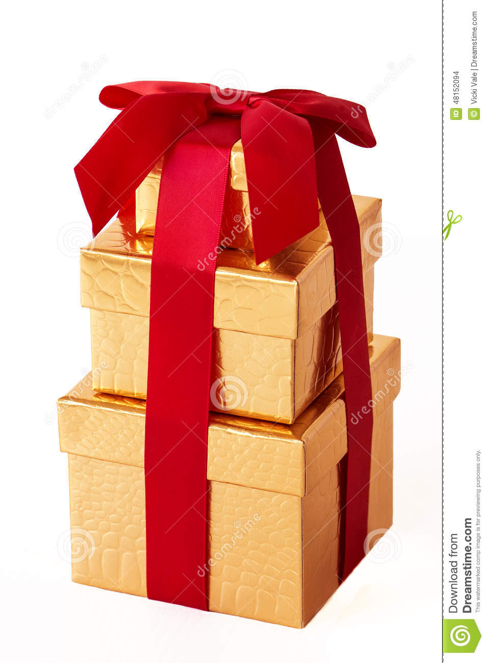 Three gold wrapped gift boxes stock photo image of