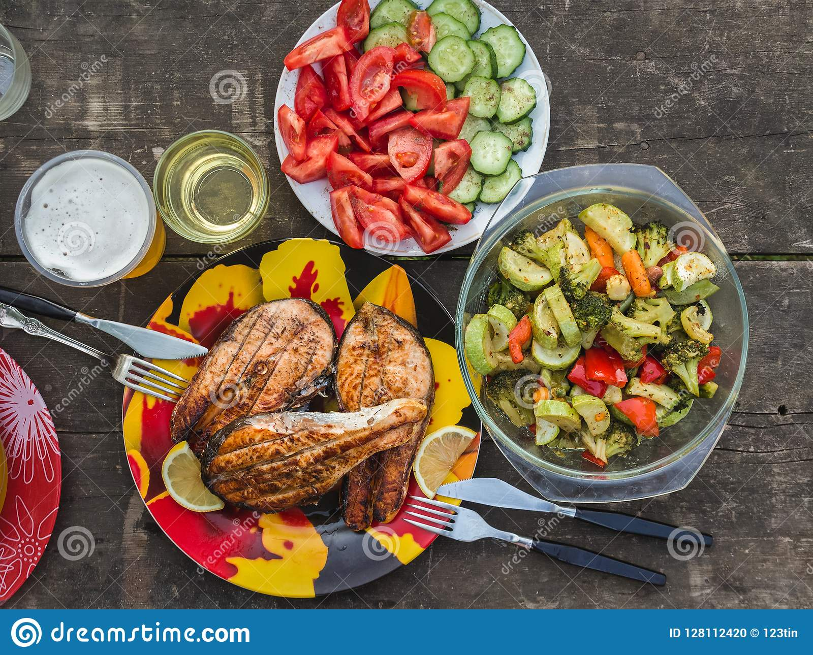 Three Grilled Salmon Steaks With A Side Dish Of Baked Vegetables Stock Photo Image Of Dinner Closeup 128112420