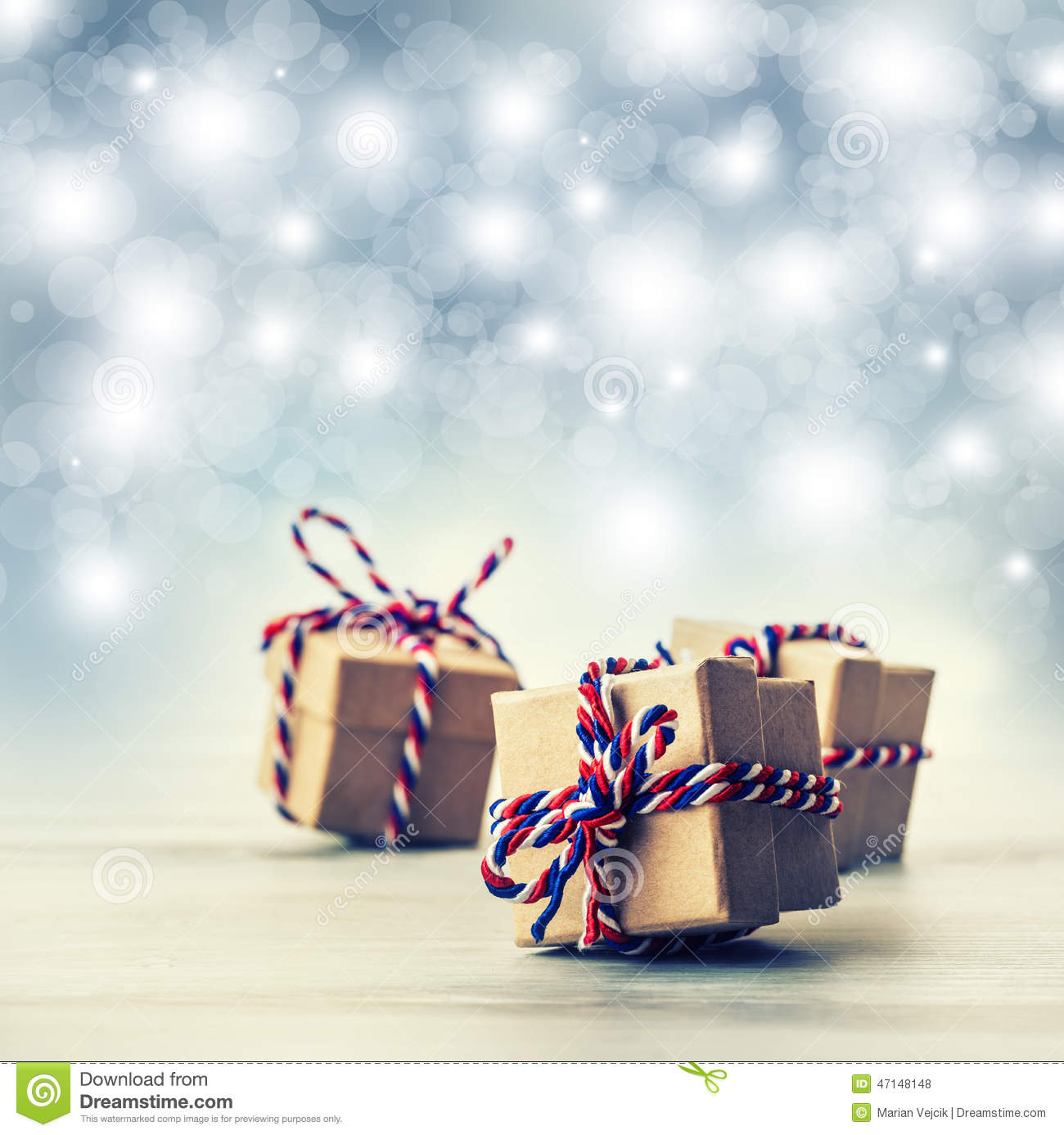 Three handmade gift boxes in shiny colour background