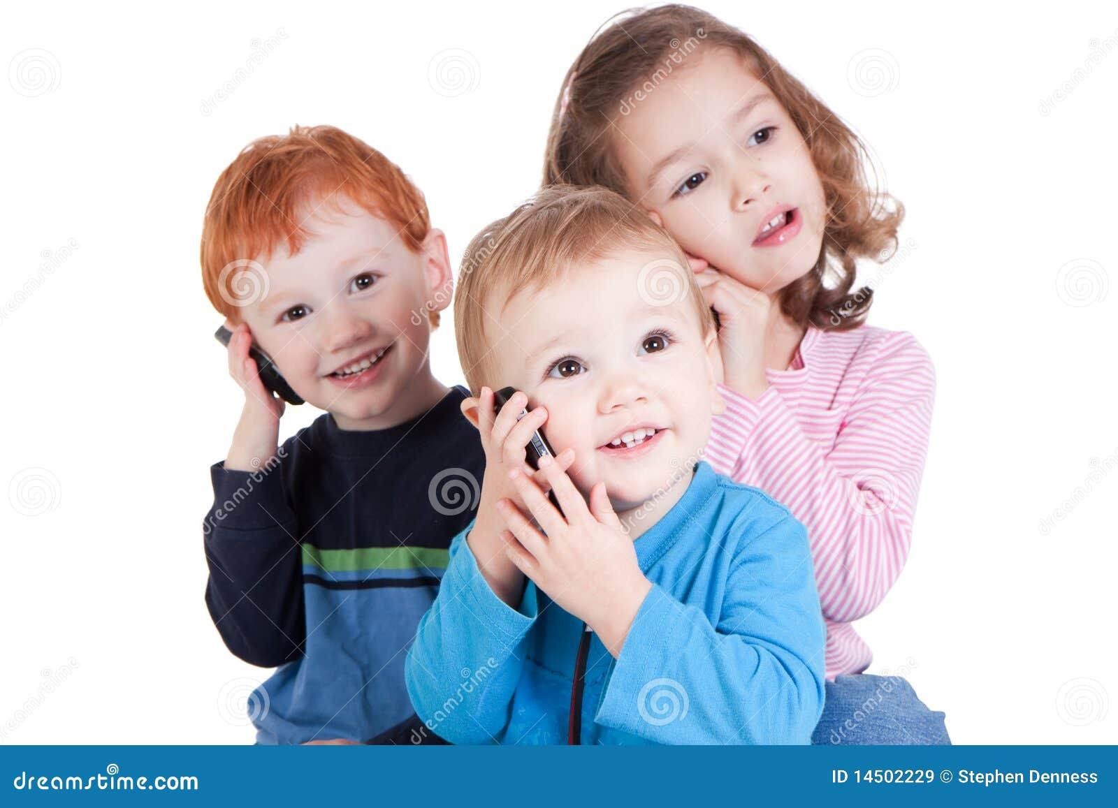 Three Happy Kids Talking On Mobile Phones Stock Image ...