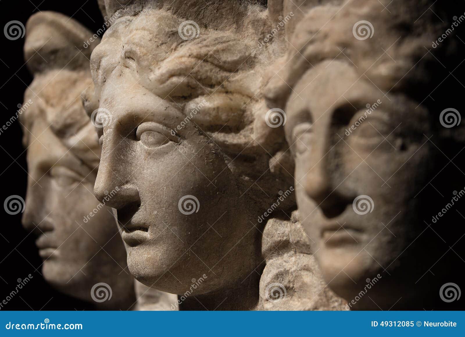 Three headed roman-asian ancient statue of beautiful women