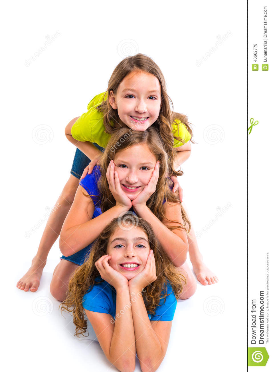 Three kid girls friends happy stacked in a row