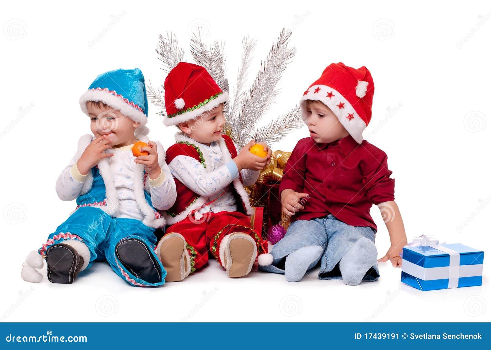 three kids in santa hats - Kids Santa
