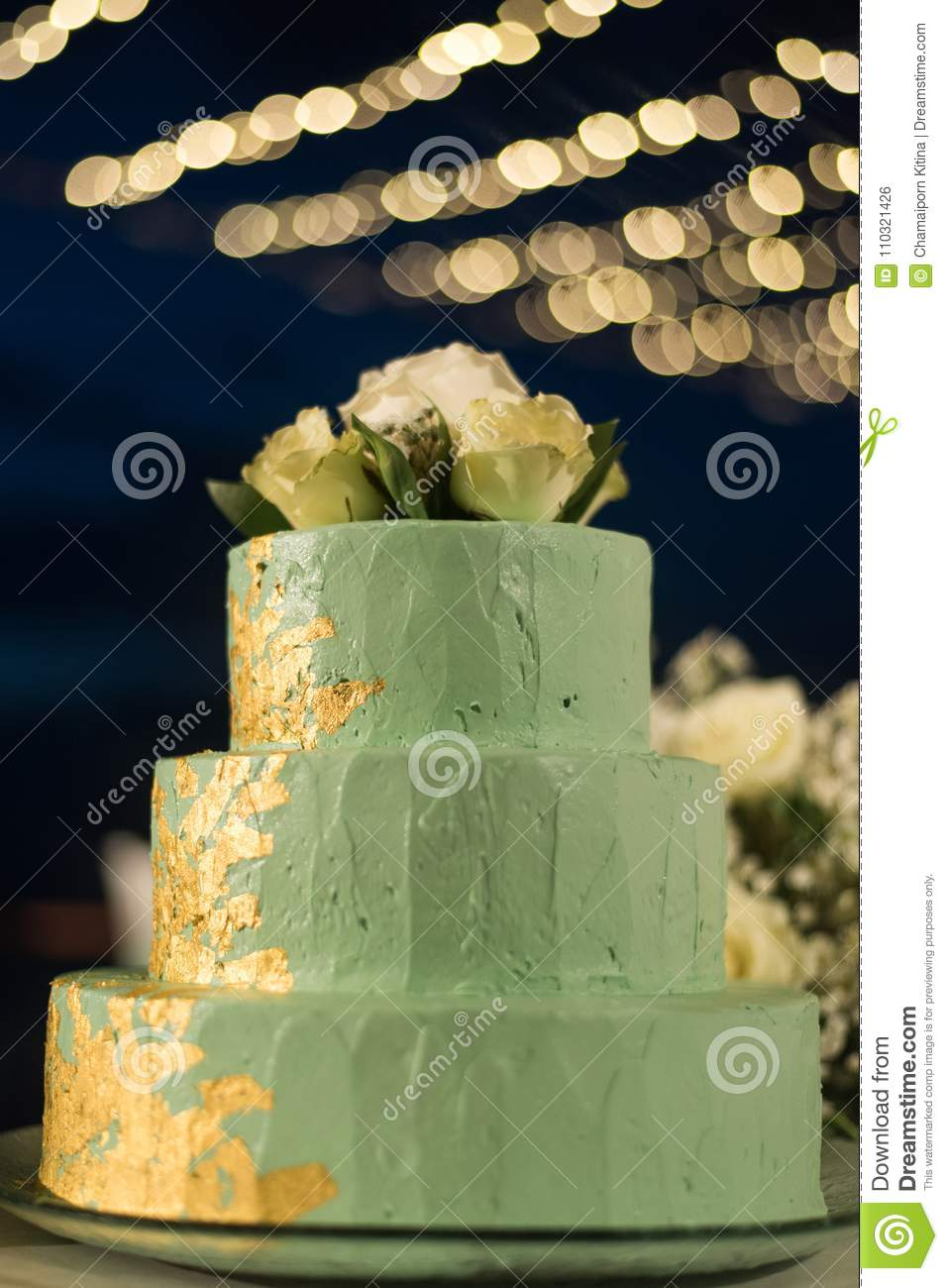 Three Layers Green Color Cake With White Rose On Top And Beautif