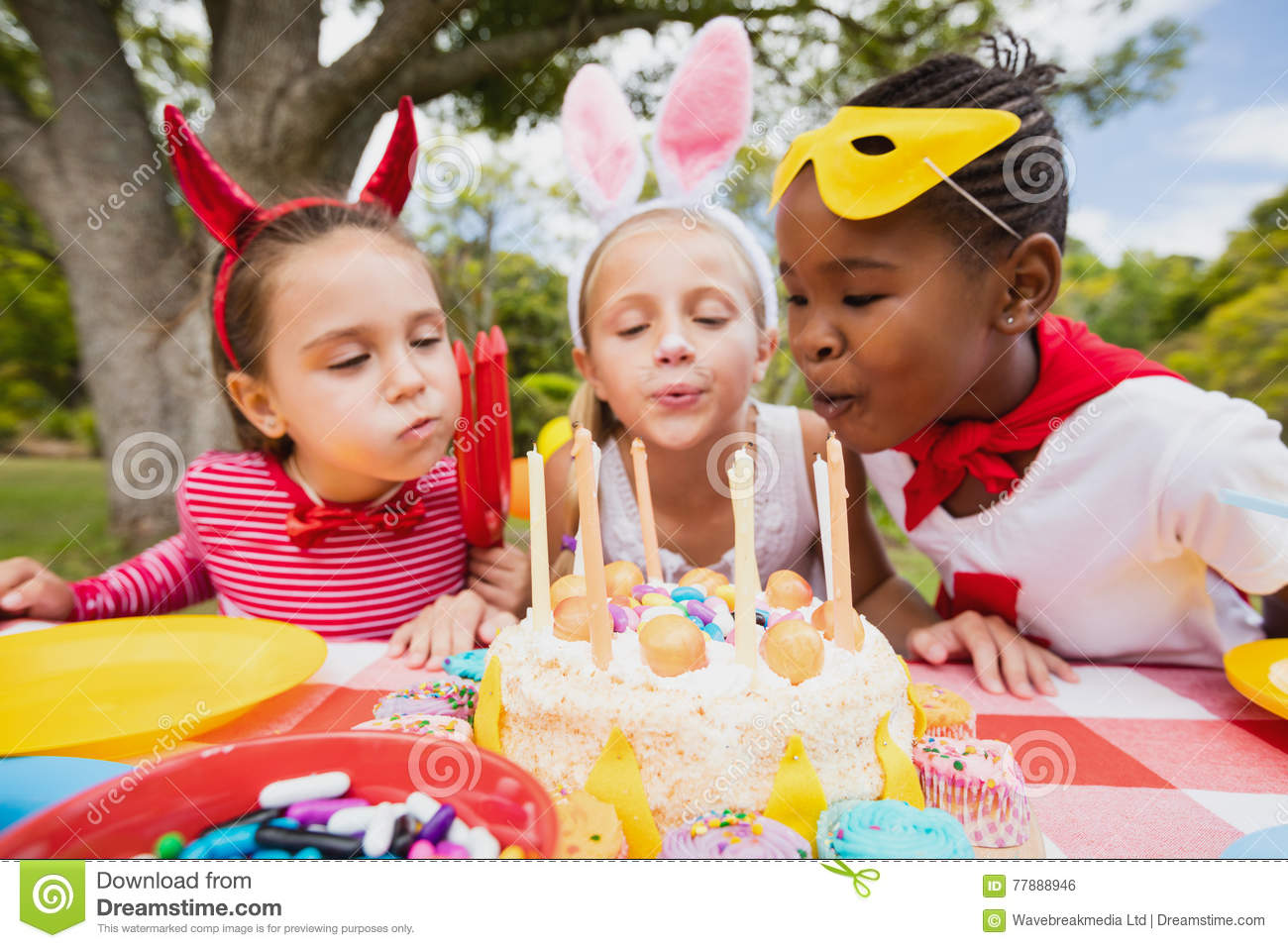 Three Little Girls Blowing Together Birthday Candles