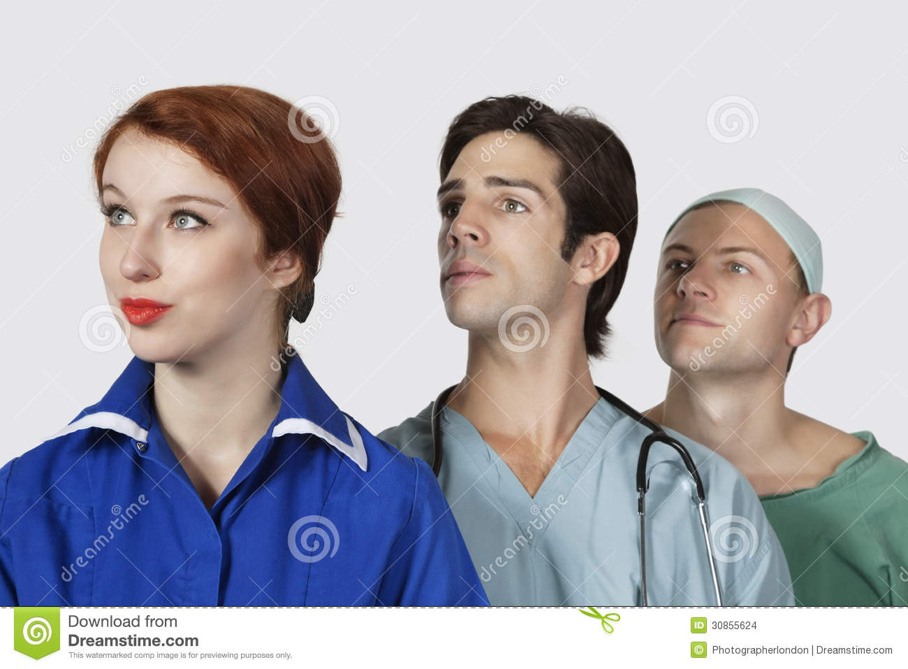 Three medical practitioners looking away against gray background