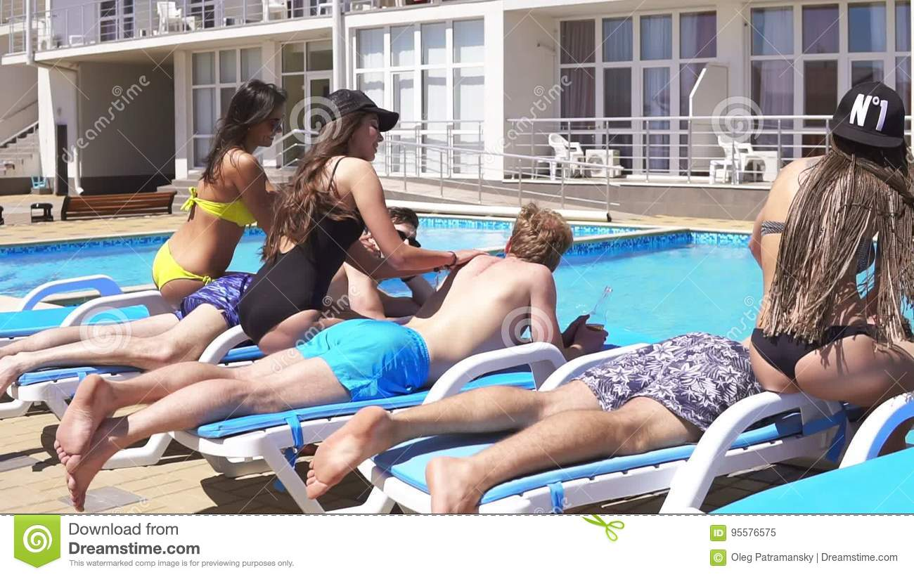 Three Men Receiving Massage From Attractive Young Girls In Bikini Lying On  Coaches By The Pool At A Beautiful Villa And Stock Video - Video of bikini,  ...