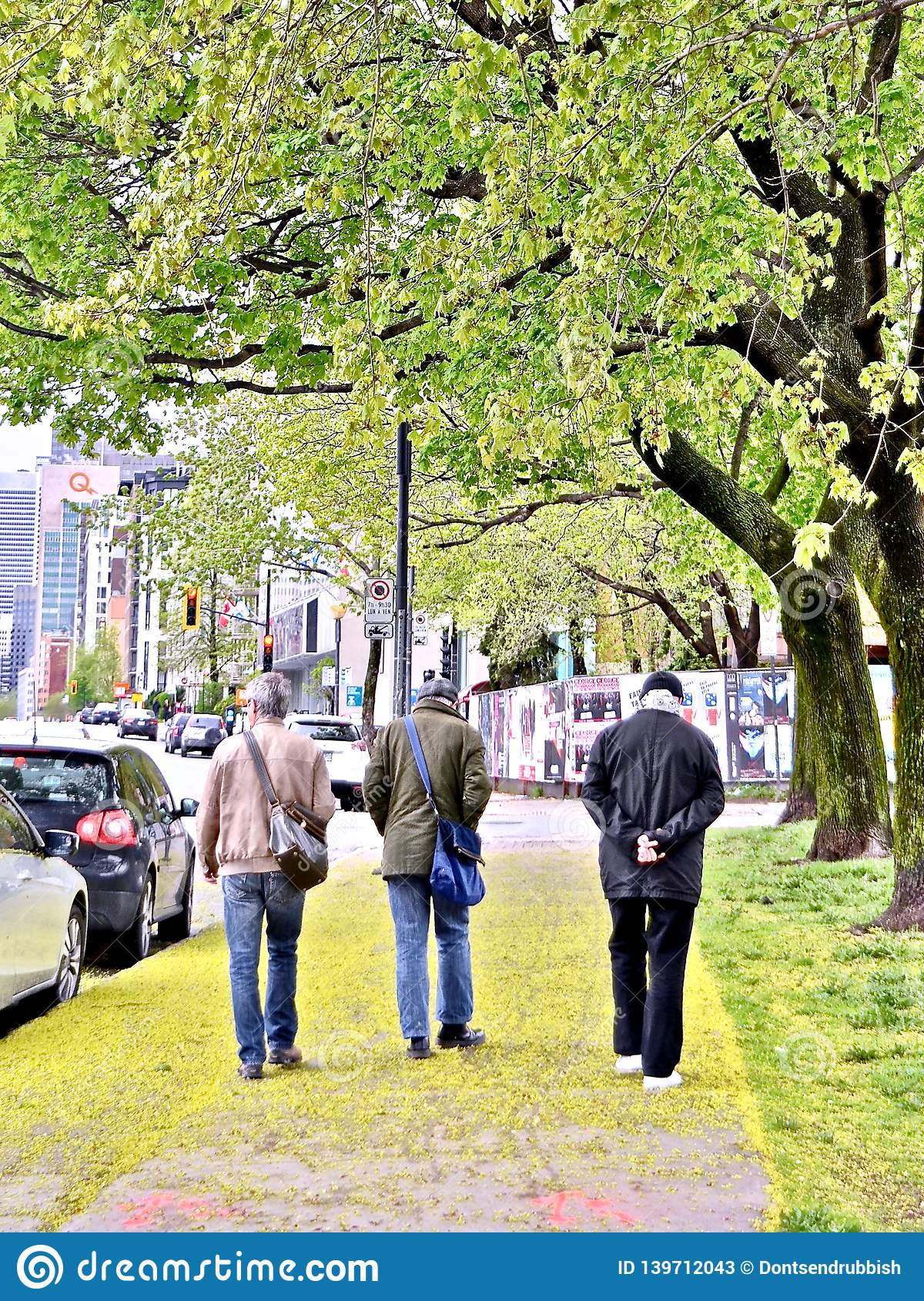 Three men out for a stroll on the streets of Montreal