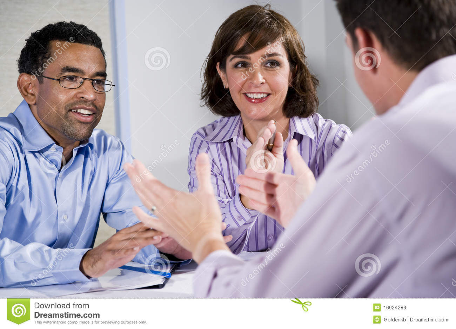 stock photos three adult people sitting table meeting image