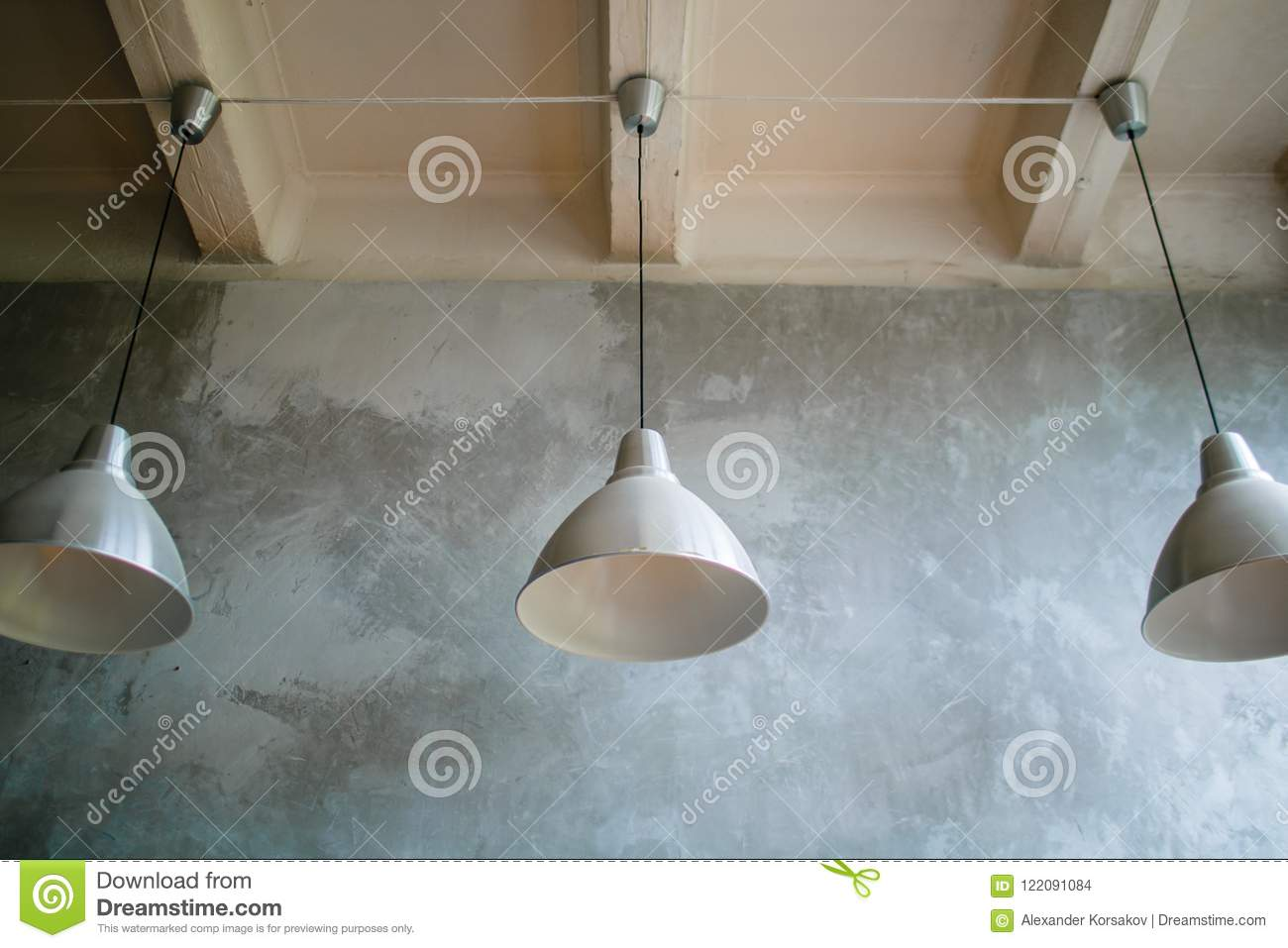 Three Modern Lamps On Concrete Ceiling White And Silver