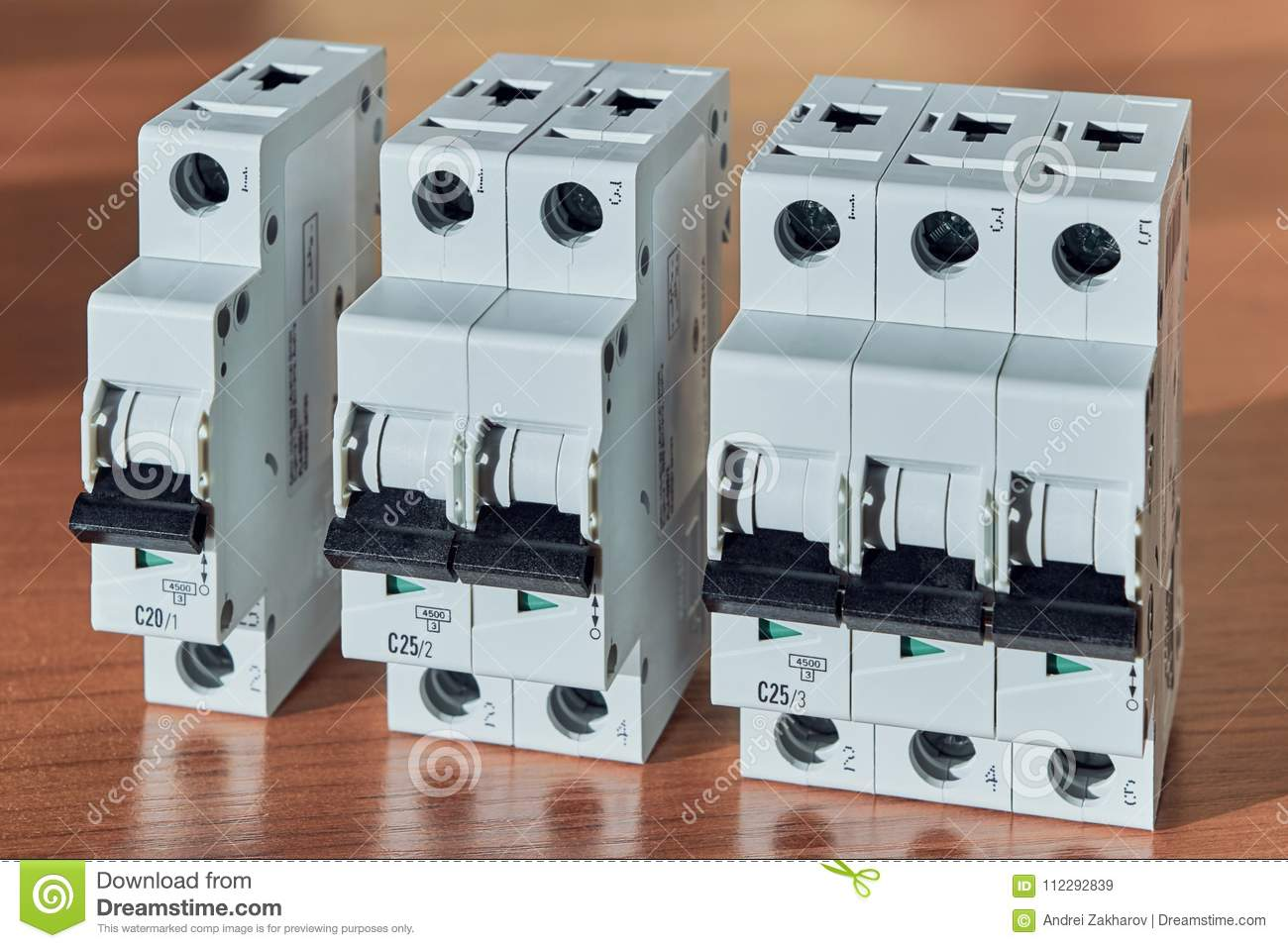Three Modular Electrical Circuit Breakers Lie On The Table Stock Wiring Of Household Switch Is Single Pole Double And Protection Or Home Use Distribution Electricity