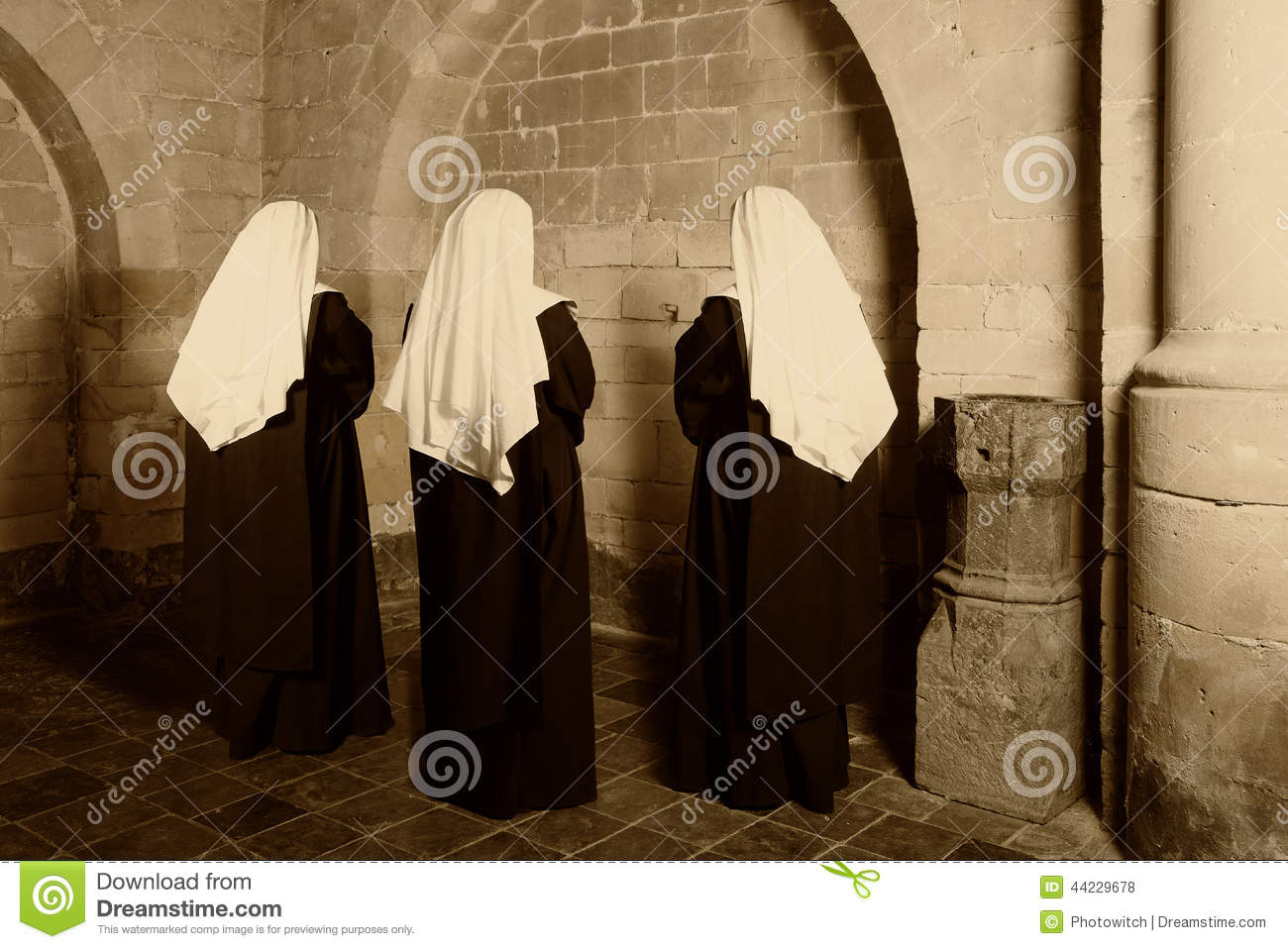 Three nuns in church