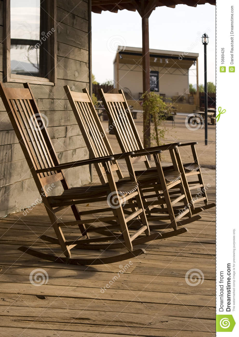 Three Old West Town Empty Rocking Chairs Stock Photo