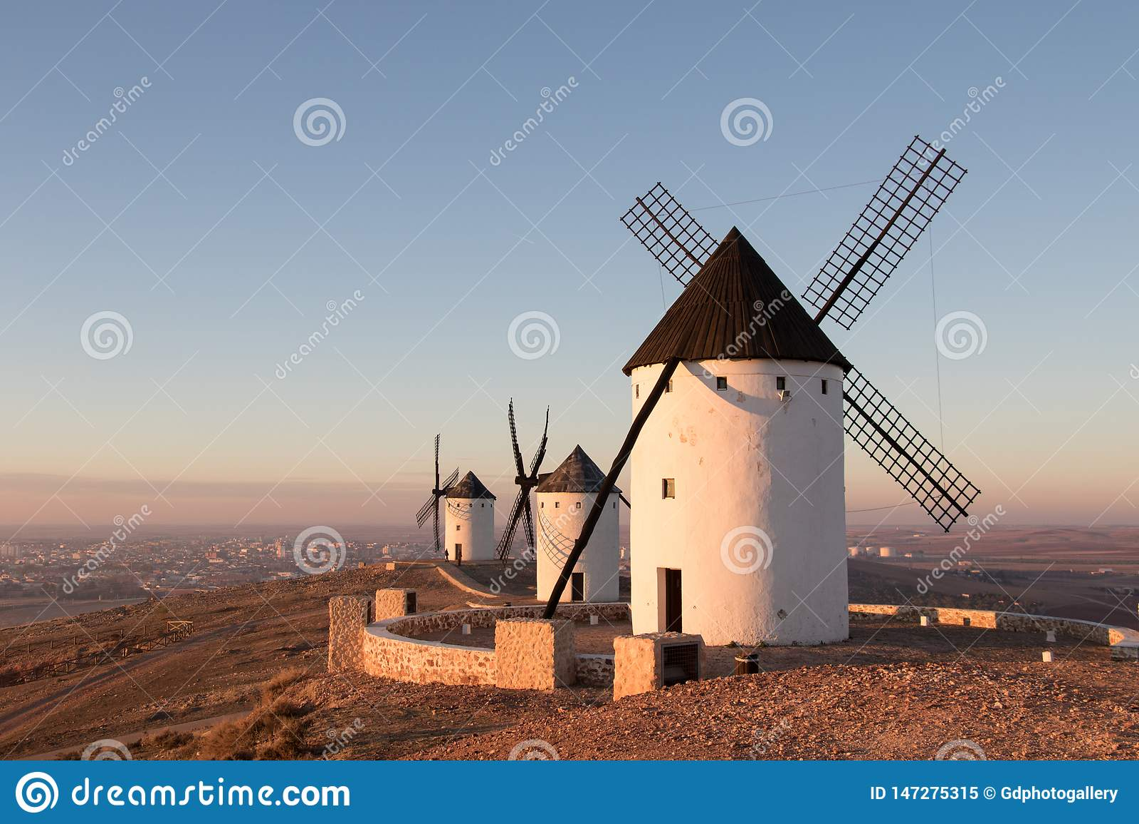 Three old windmills in Alcazar de San Juan, Casilla la Mancha. Don Quixote route. Spain