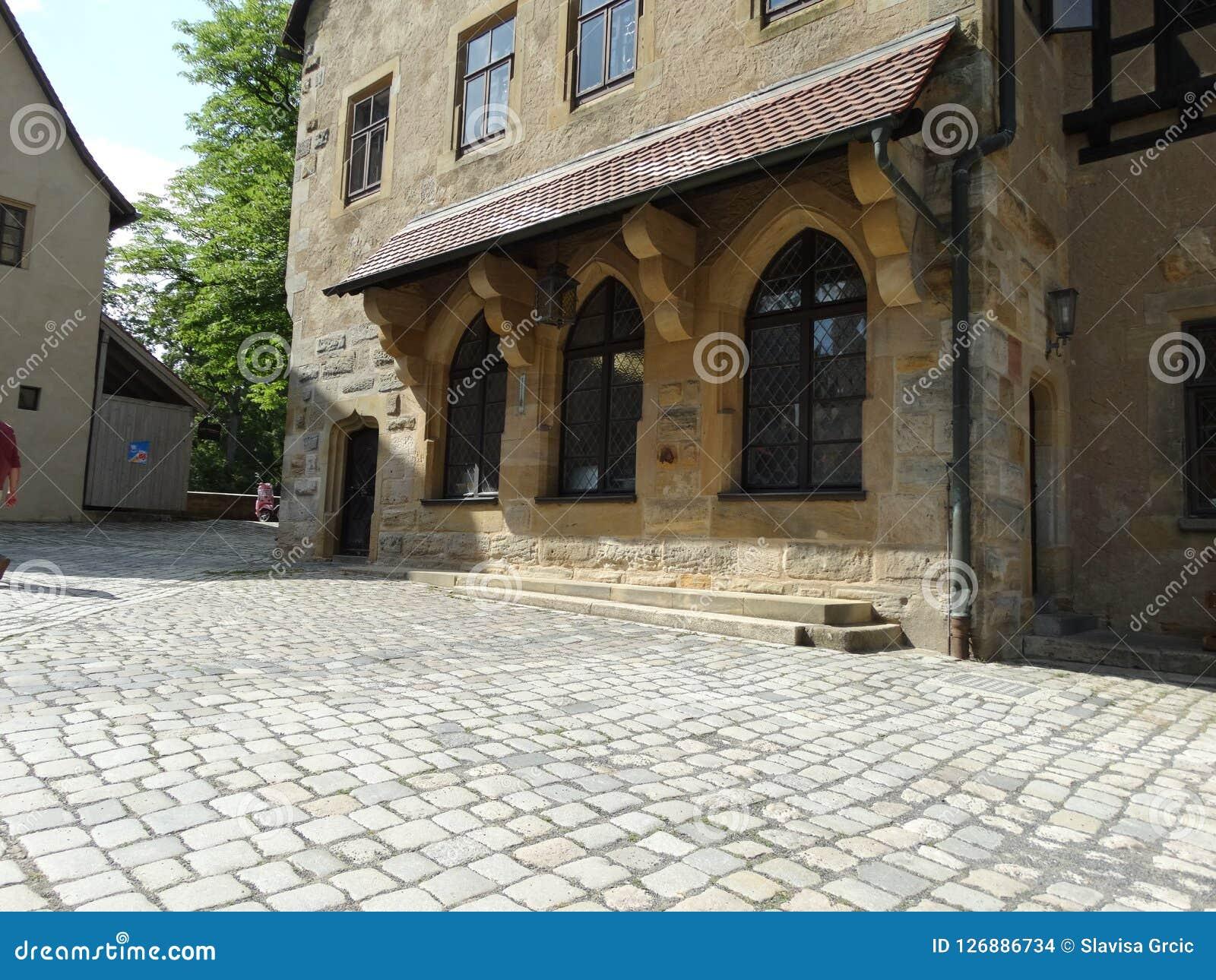 Three old windows on a stone façade