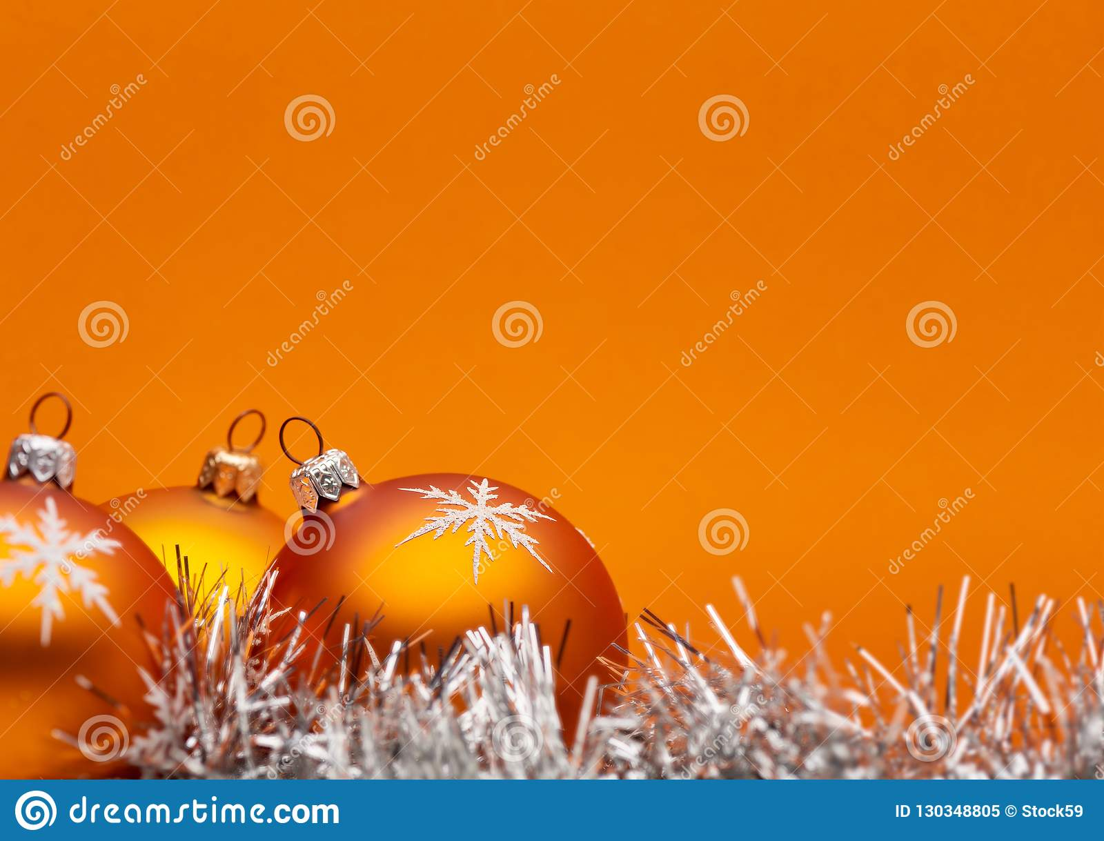 Three Orange Bauble Christmas Decorations Close Up Against An Orange Background With Space For Adding Text Stock Image Image Of Decorate Colour 130348805