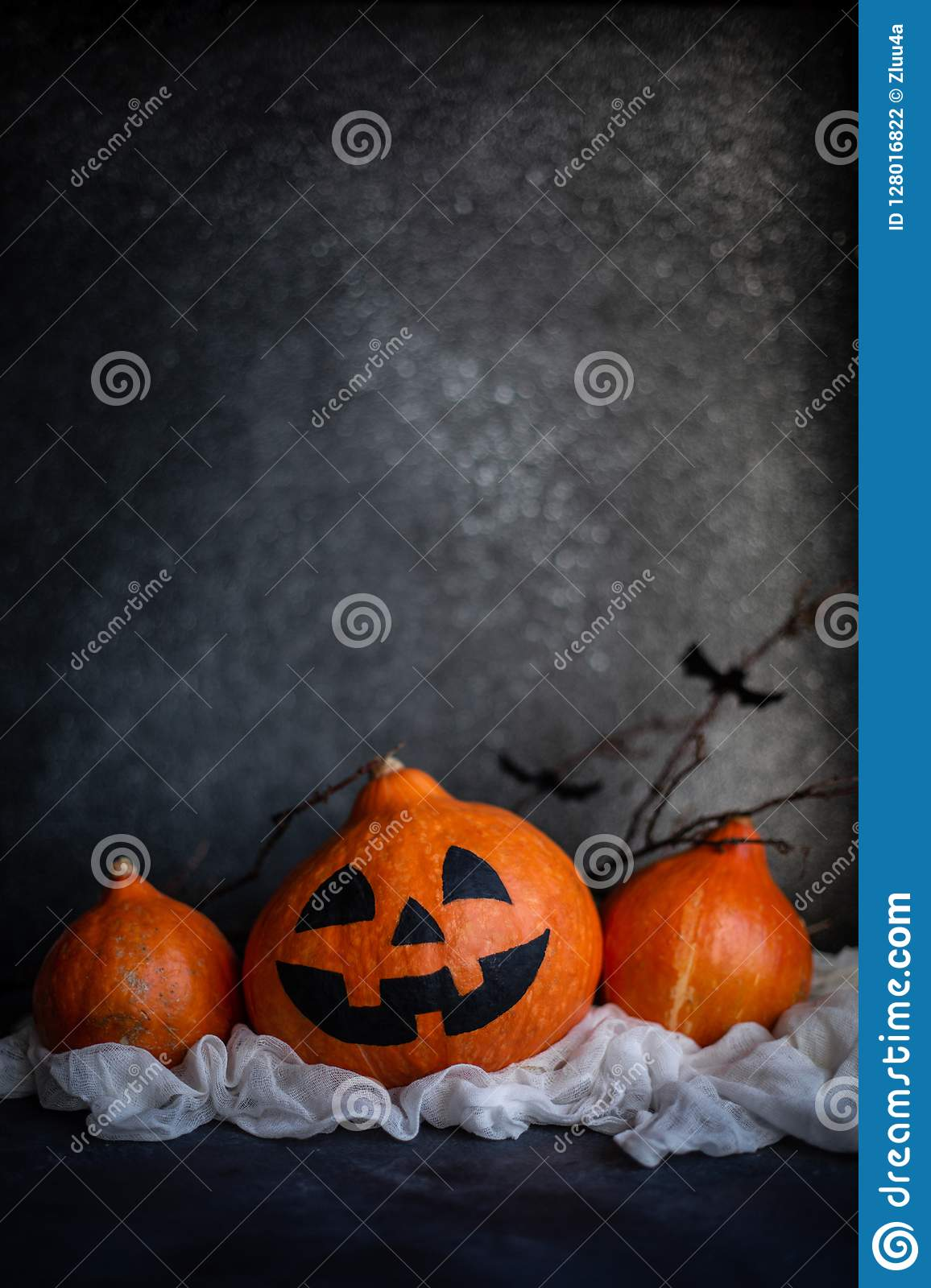 Funny pumpkin Jack decorated with cobweb and bats.
