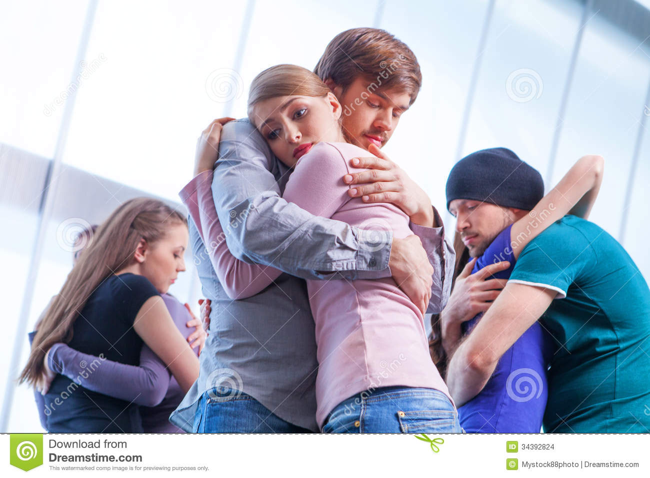 Three Pair Of People Hugging Each Other. Stock Photo ...