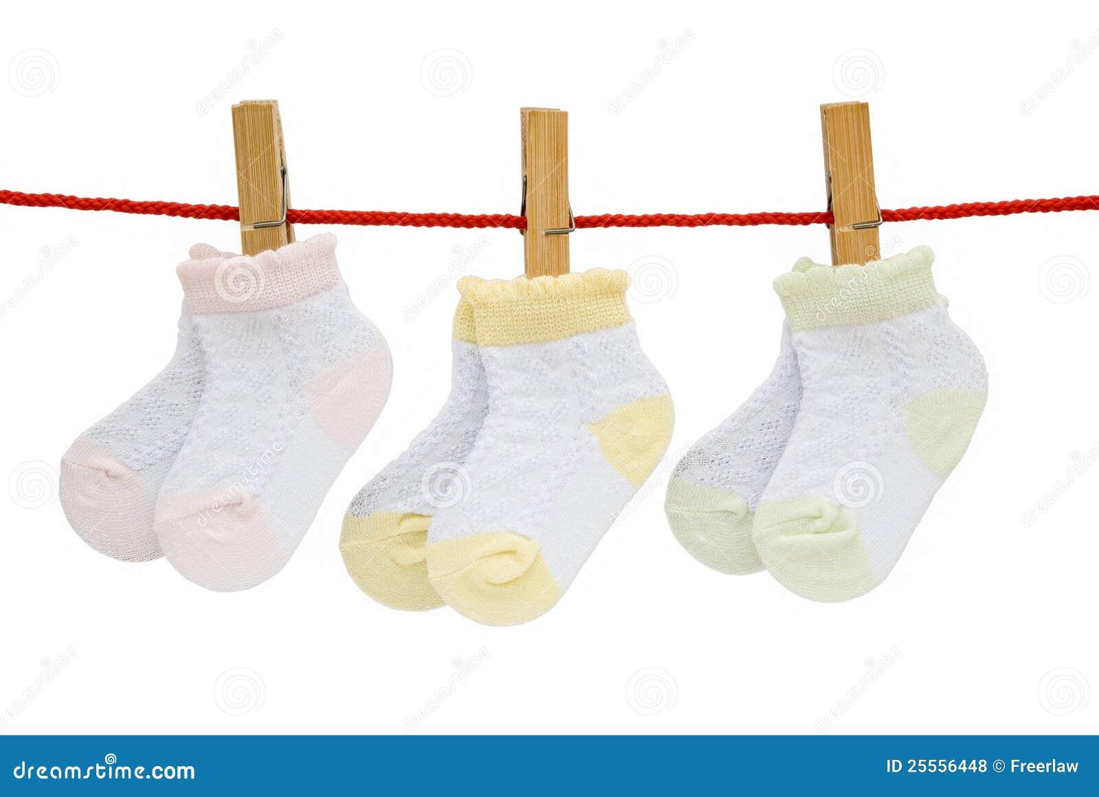 Three Pairs Baby Socks Hanging Stock Photo - Image: 25556448