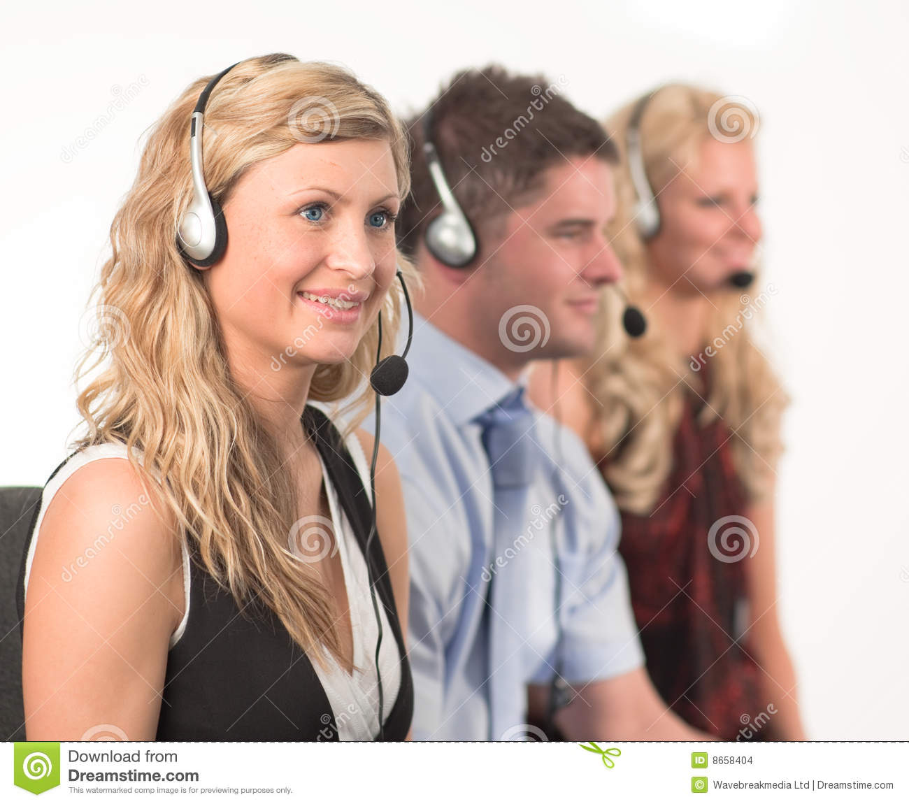Three working in a call centre with headsets